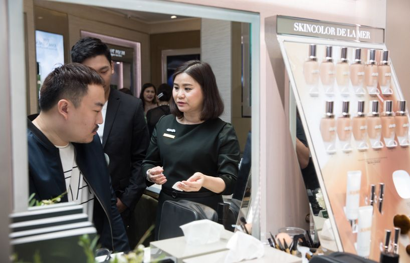 Kenny Yee (far left) listening intently to the brand rep explaining the many benefits of La Mer.