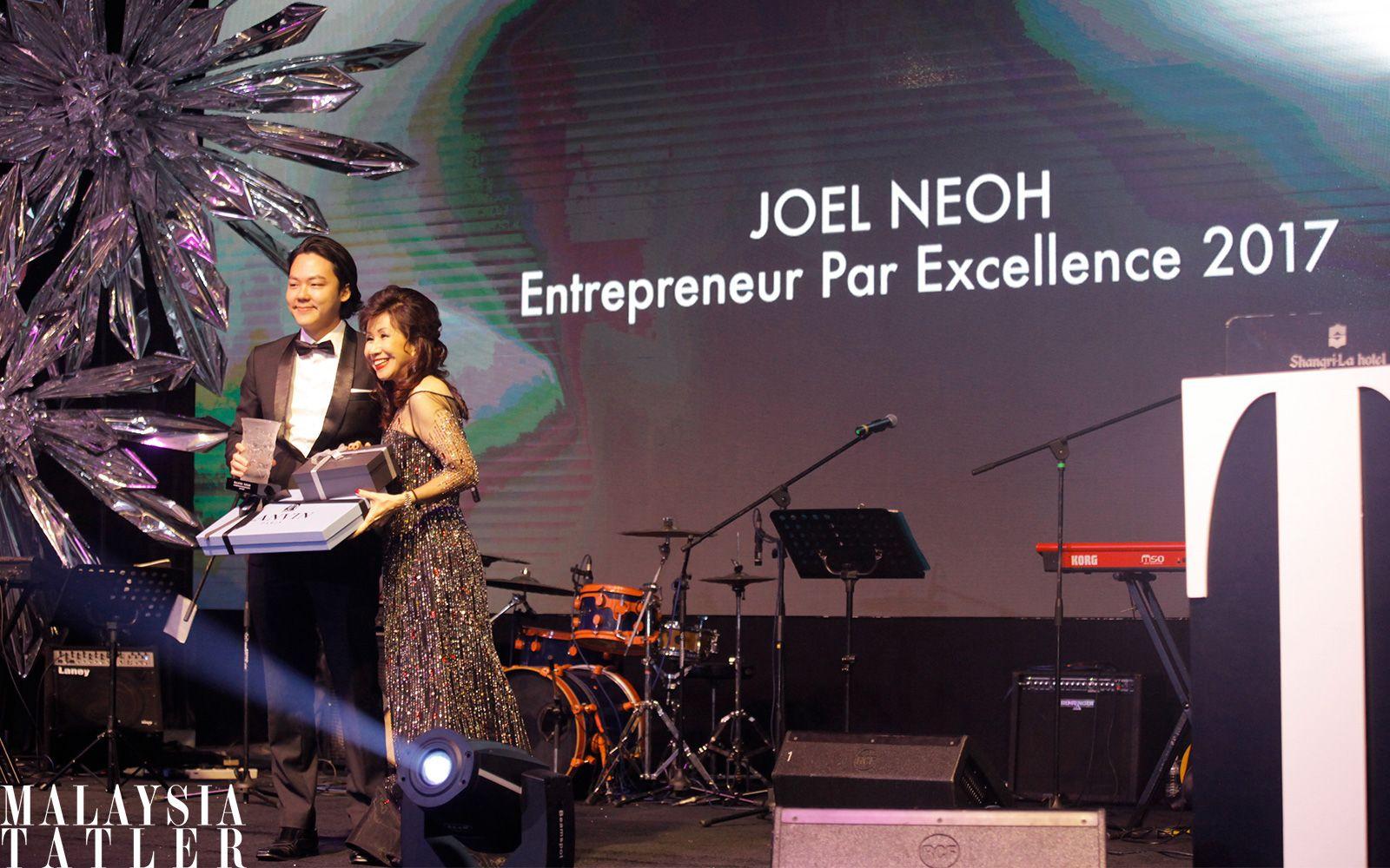 Joel Neoh receiving his award