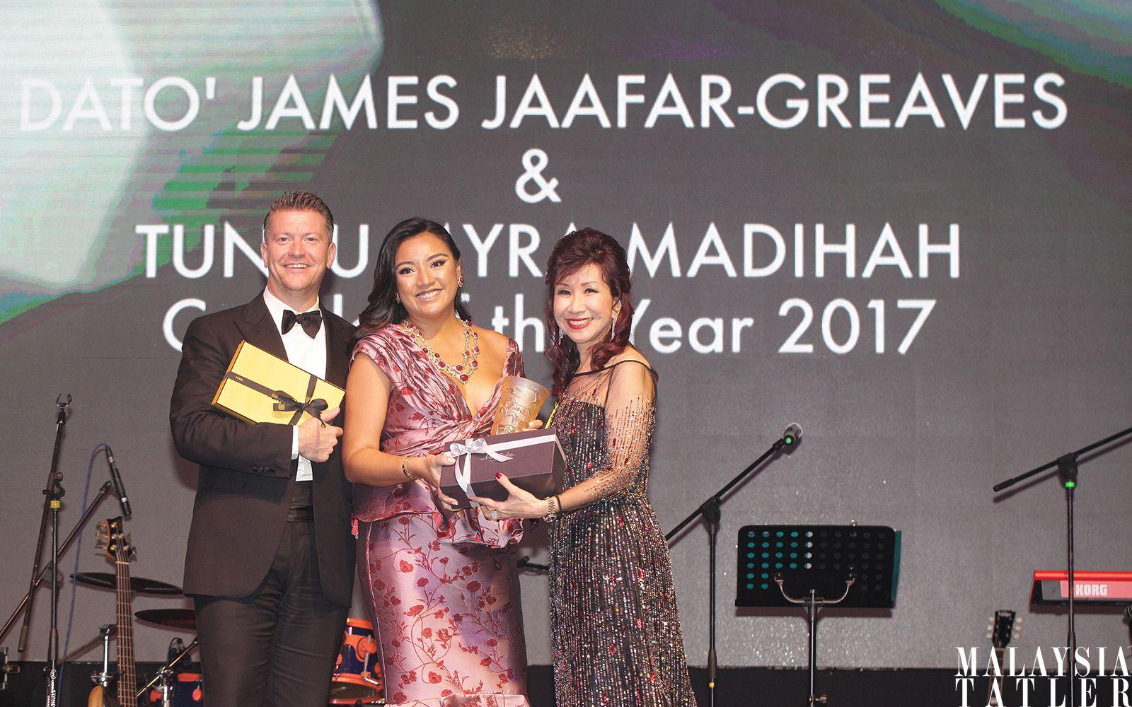 Dato' James Jaafar-Greaves and Tunku Datin Myra Madihah receiving their award