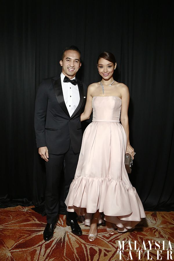Nasarudin Nasimuddin and Marion Caunter in Reem Acra and Chanel accessories