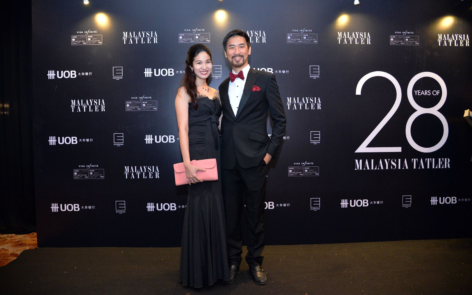Melissa Lam in Neiman Marcus dress and Hermes bag and Daryl Foong