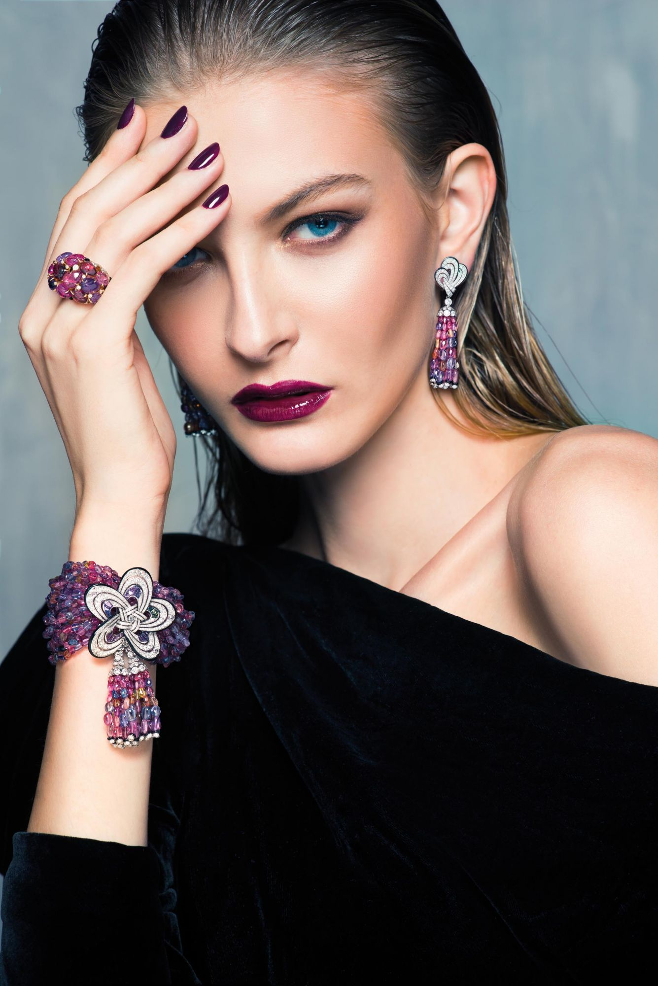 THINK PINK: Earrings, ring and bracelet in white gold set with multi-coloured sapphires, onyx and diamonds by Cartier; dress by Tom Ford