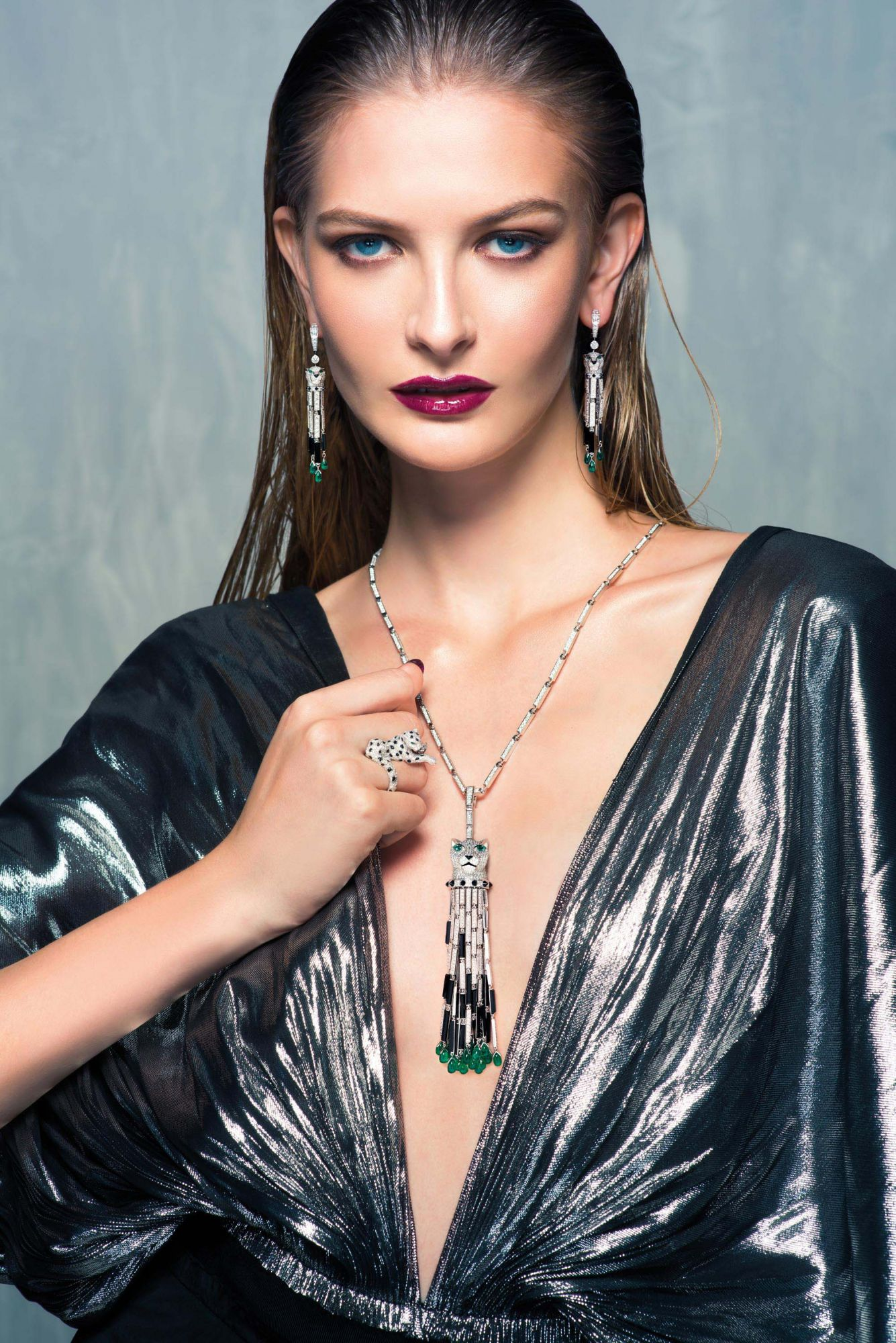 WILD AT HEART: Earrings, ring and necklace in white gold set with diamonds, emeralds and onyx by Cartier; dress by Loewe