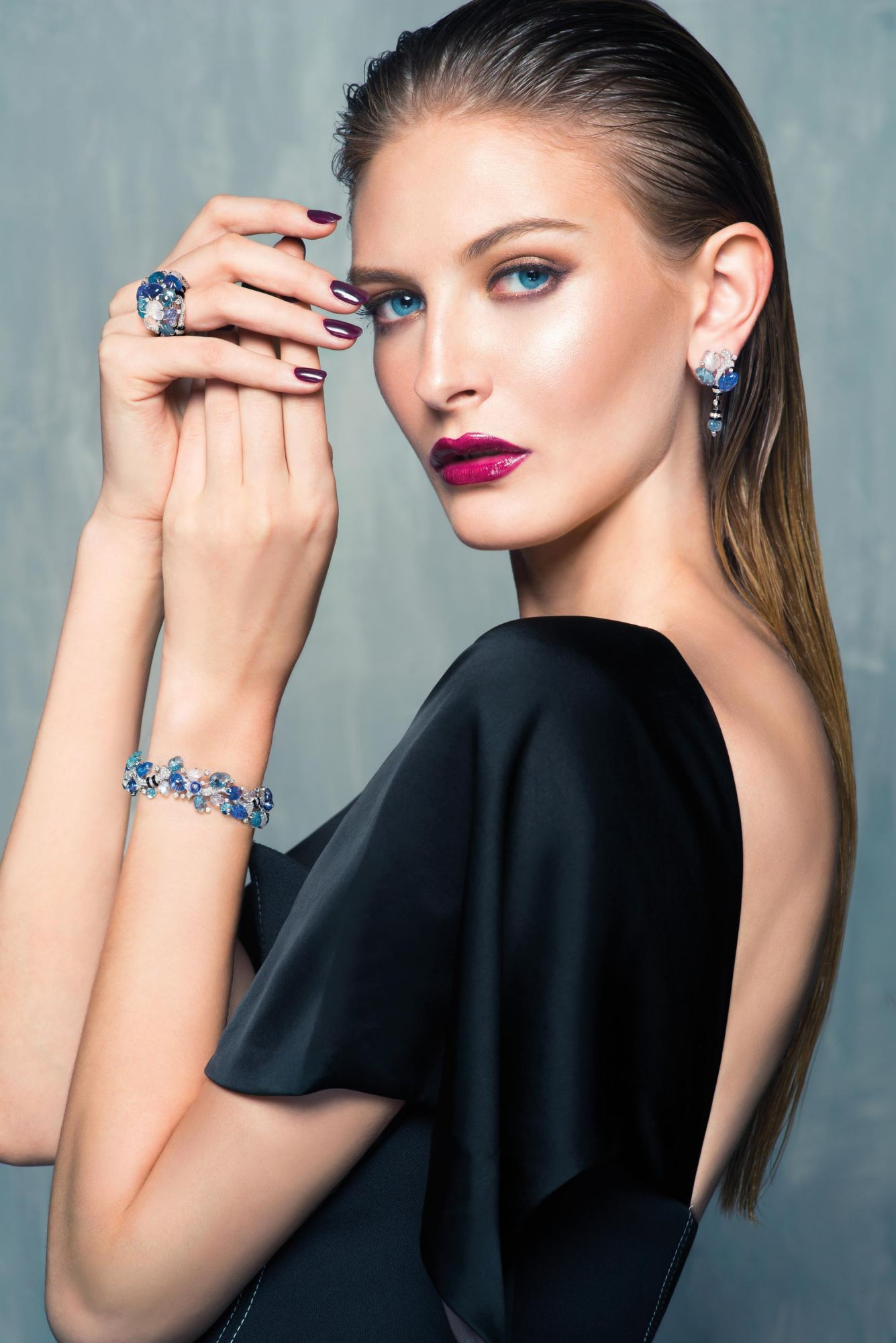 BLUE CRUSH: Earrings, ring and bracelet in white gold set with diamonds, aquamarines, tanzanites, moonstones and onyx by Cartier; dress by Diane von Furstenberg