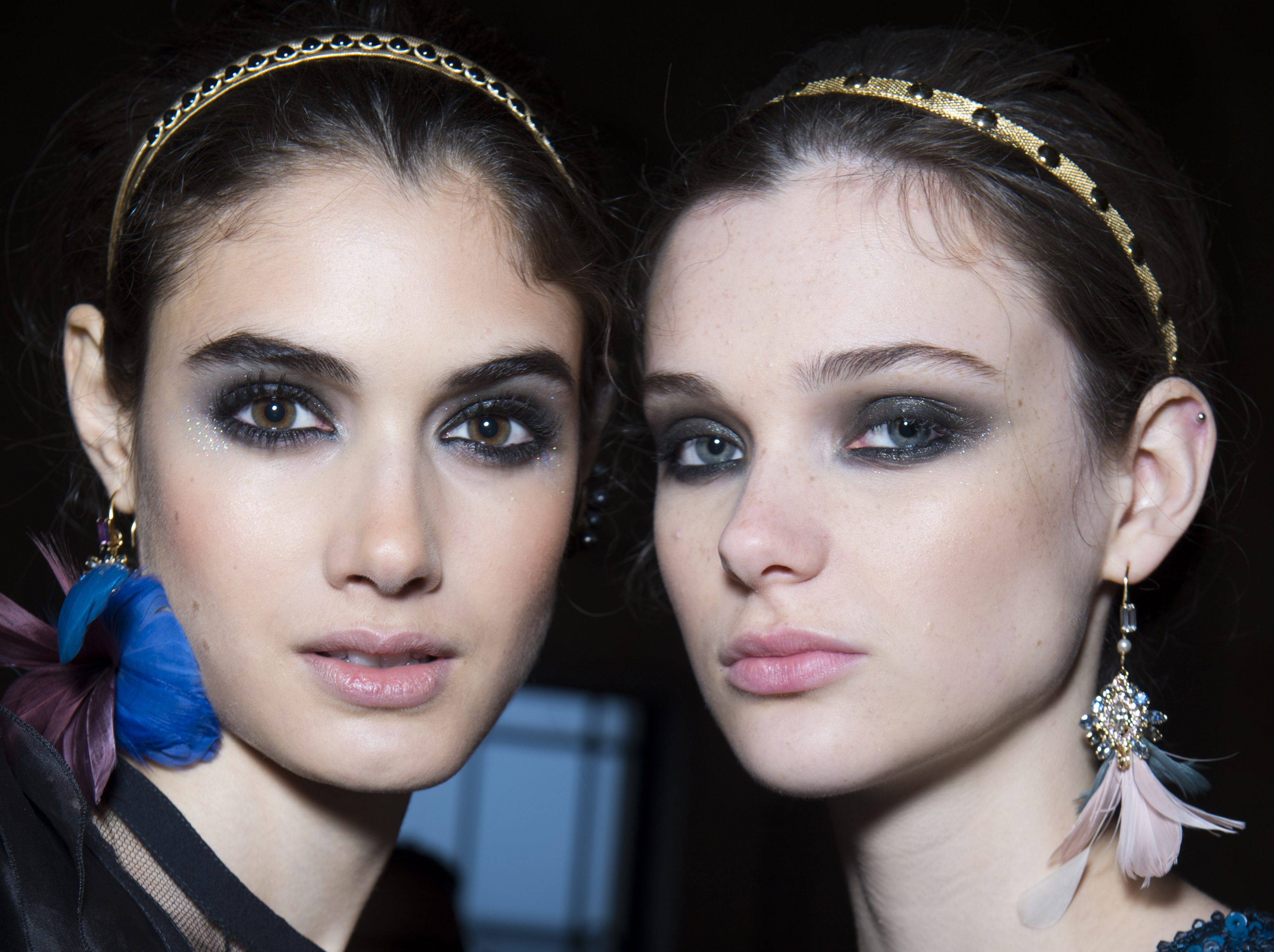 Pewter sparkly eyes spotted at Elie Saab's F/W18 show, created by makeup artist Tom Pecheux with two different glitters that drift down the cheekbones