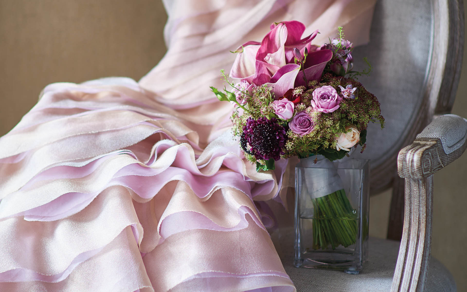 Bouquet of calla lilies, mini roses, clematis and dill by Armani/Fiori; dress by Vivian Luk; chair from Bowerbird Home