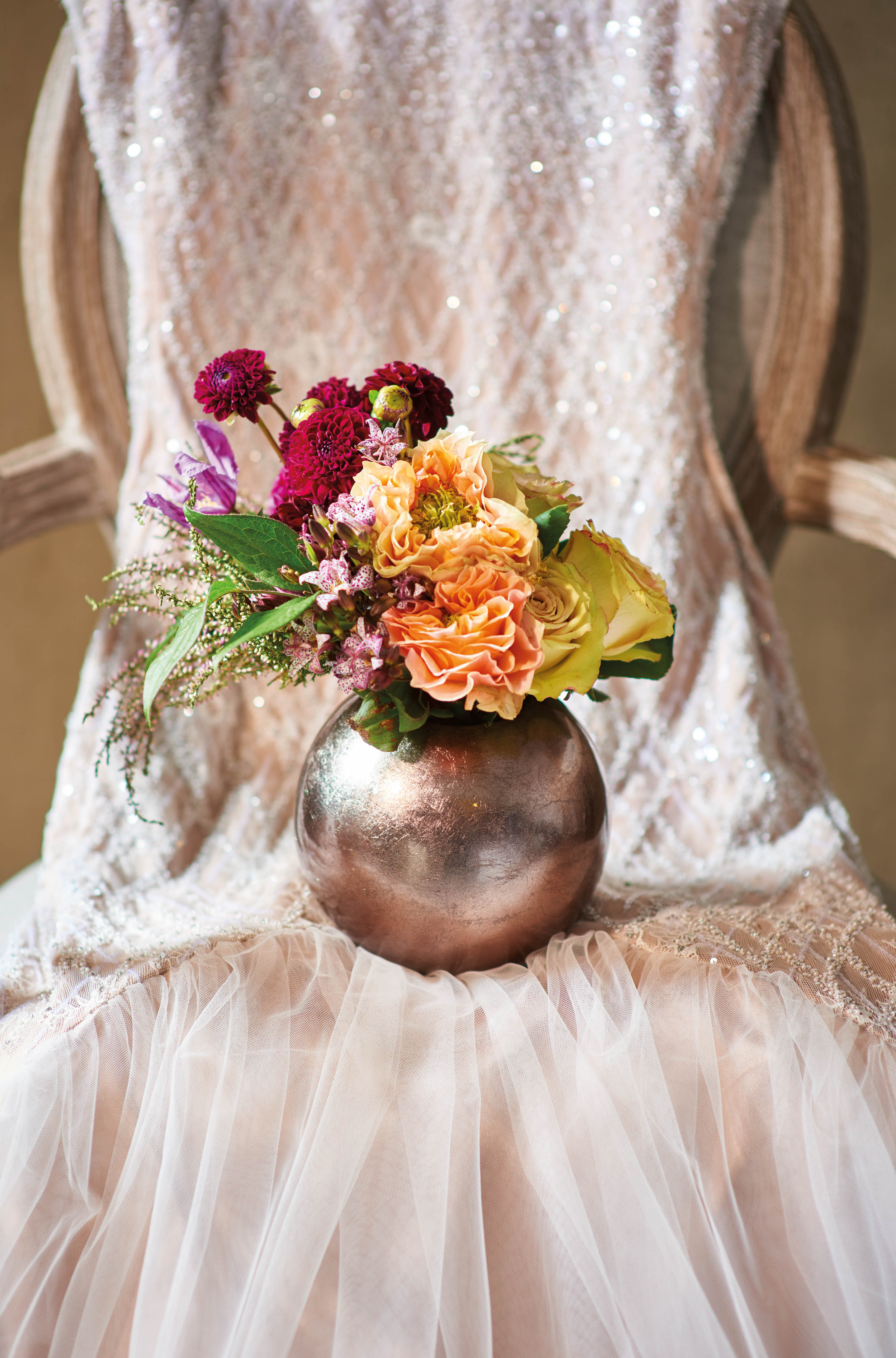 Bouquet of roses, dahlias  and garden roses by Armani/Fiori; dress by Rania Hatoum; chair from Bowerbird Home