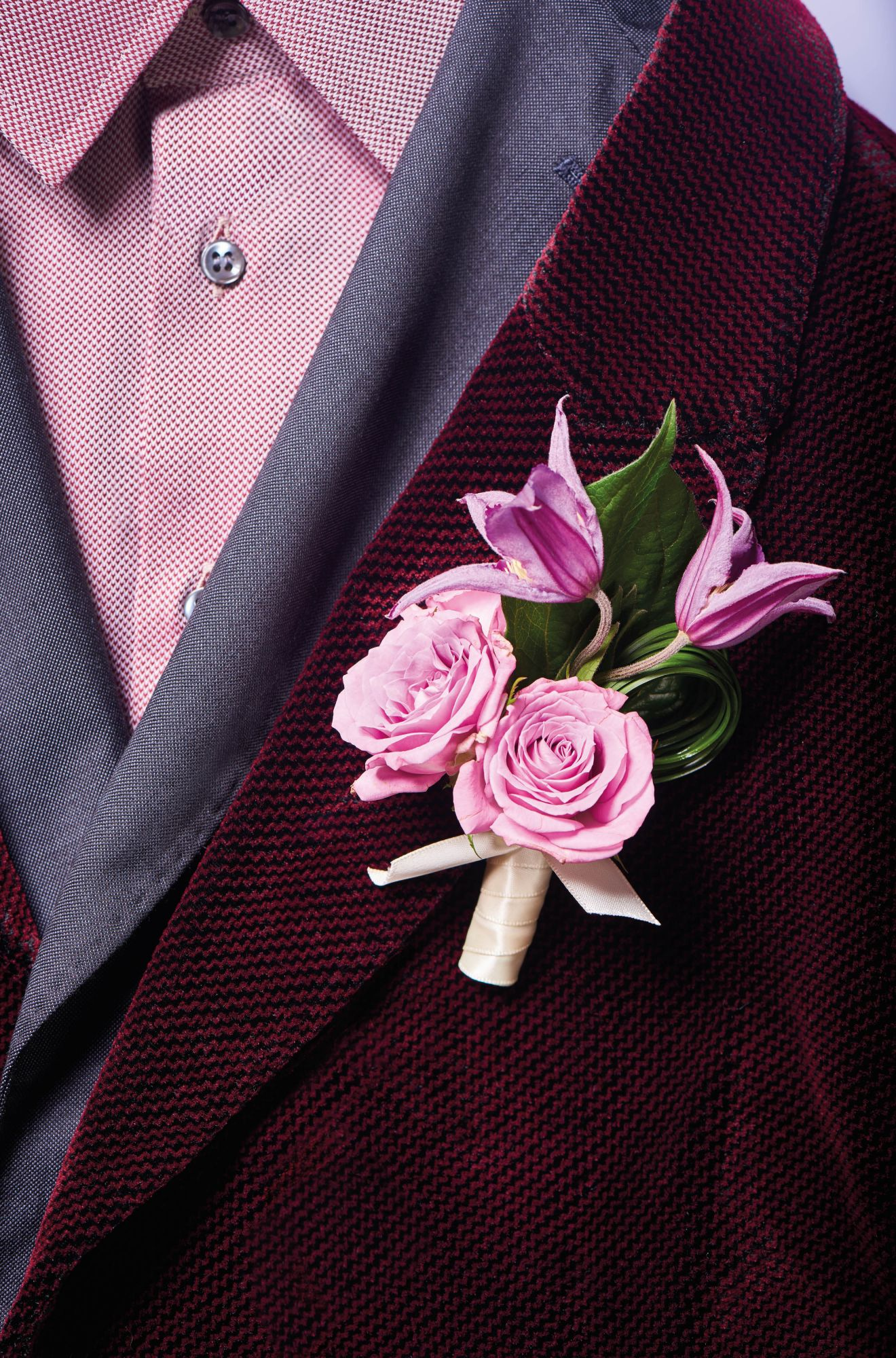 Boutonnière of clematis and roses by Armani/Fiori; shirt and jackets by Giorgio Armani