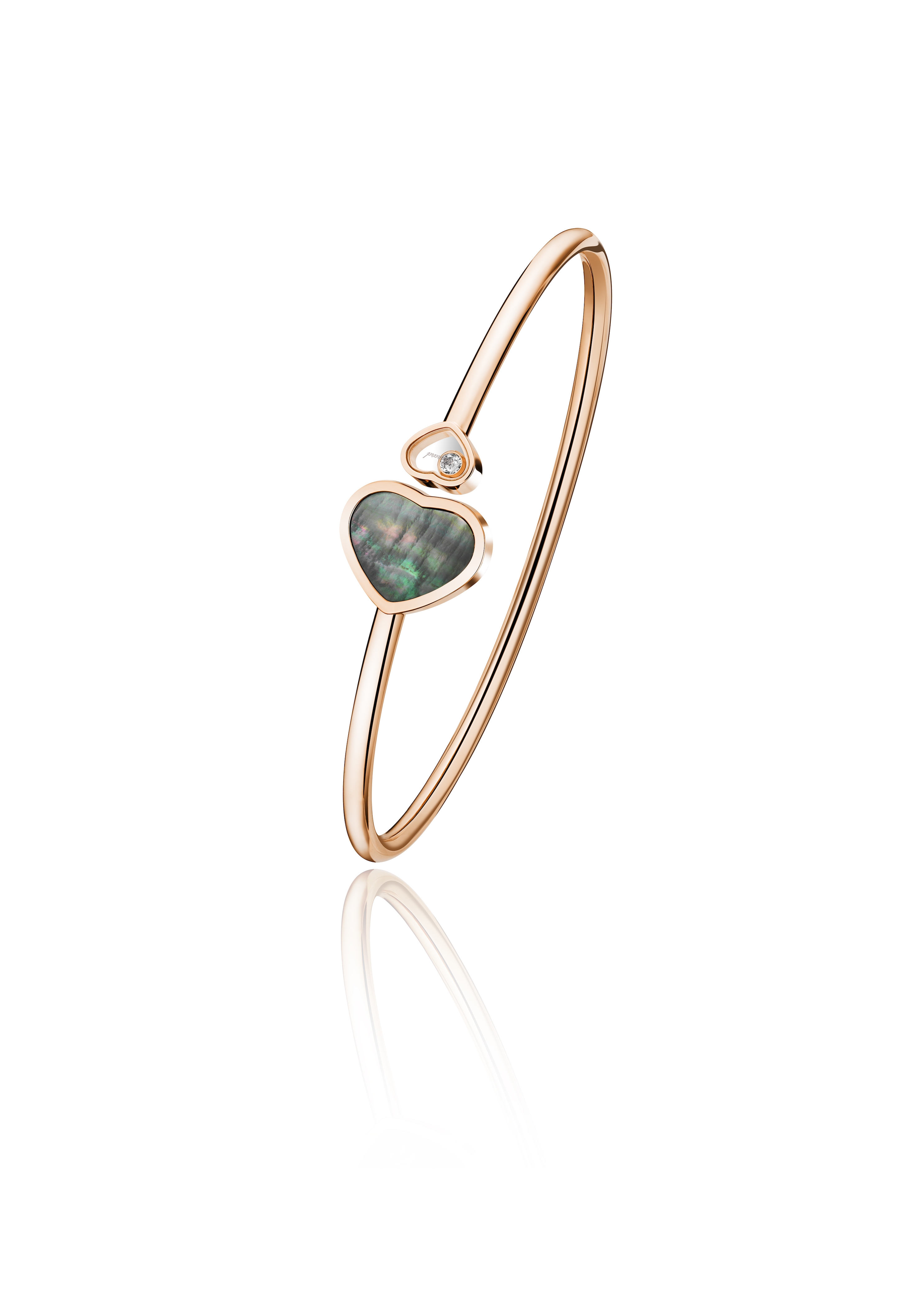 Happy Hearts bangle set with black Tahiitian mother-of-pearl and diamonds. (Photo: Courtesy of Chopard)