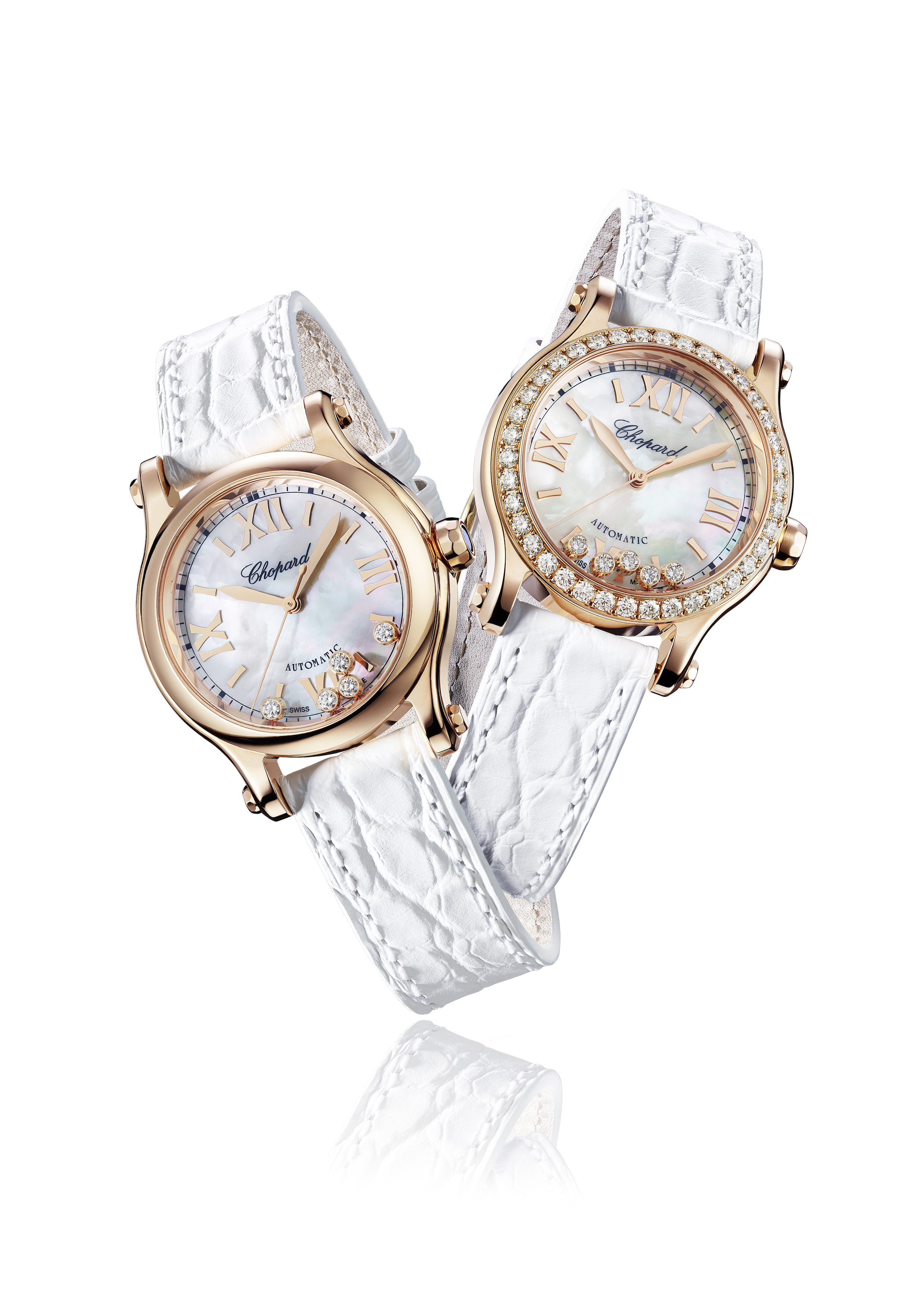 Happy Sport watches with white dials and rose gold cases. (Photo: Courtesy of Chopard)