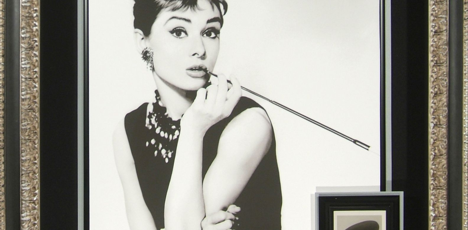 Audrey Hepburn - Exceedingly Rare Vintage Signed Portrait atop a Photo by Bud Fraker (Photo: Courtesy of Areteos Historical Concept)