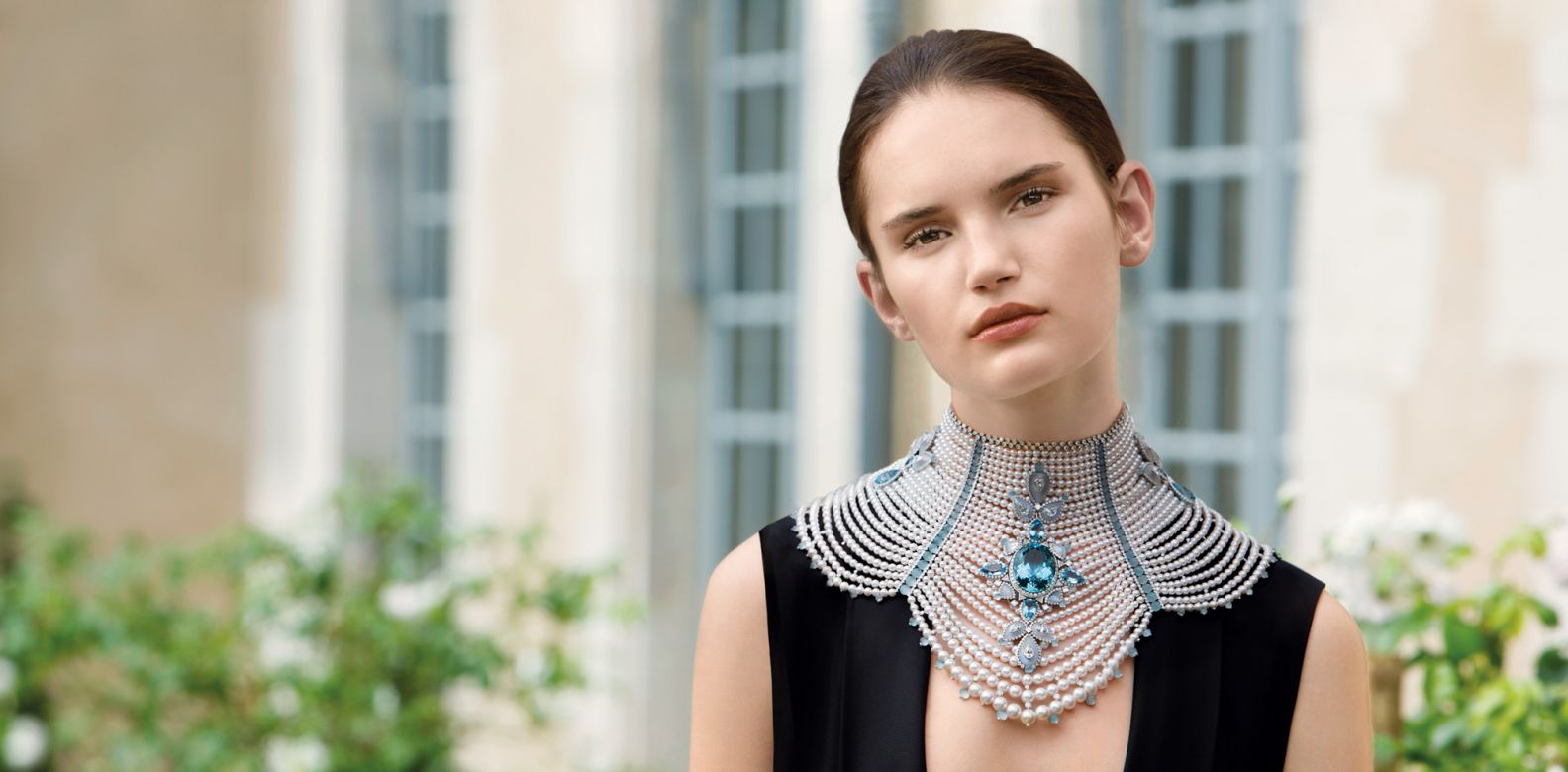 Baïkal necklace in white gold set with pearls, moonstones, aquamarines and diamonds, by Boucheron; jumpsuit by Lanvin