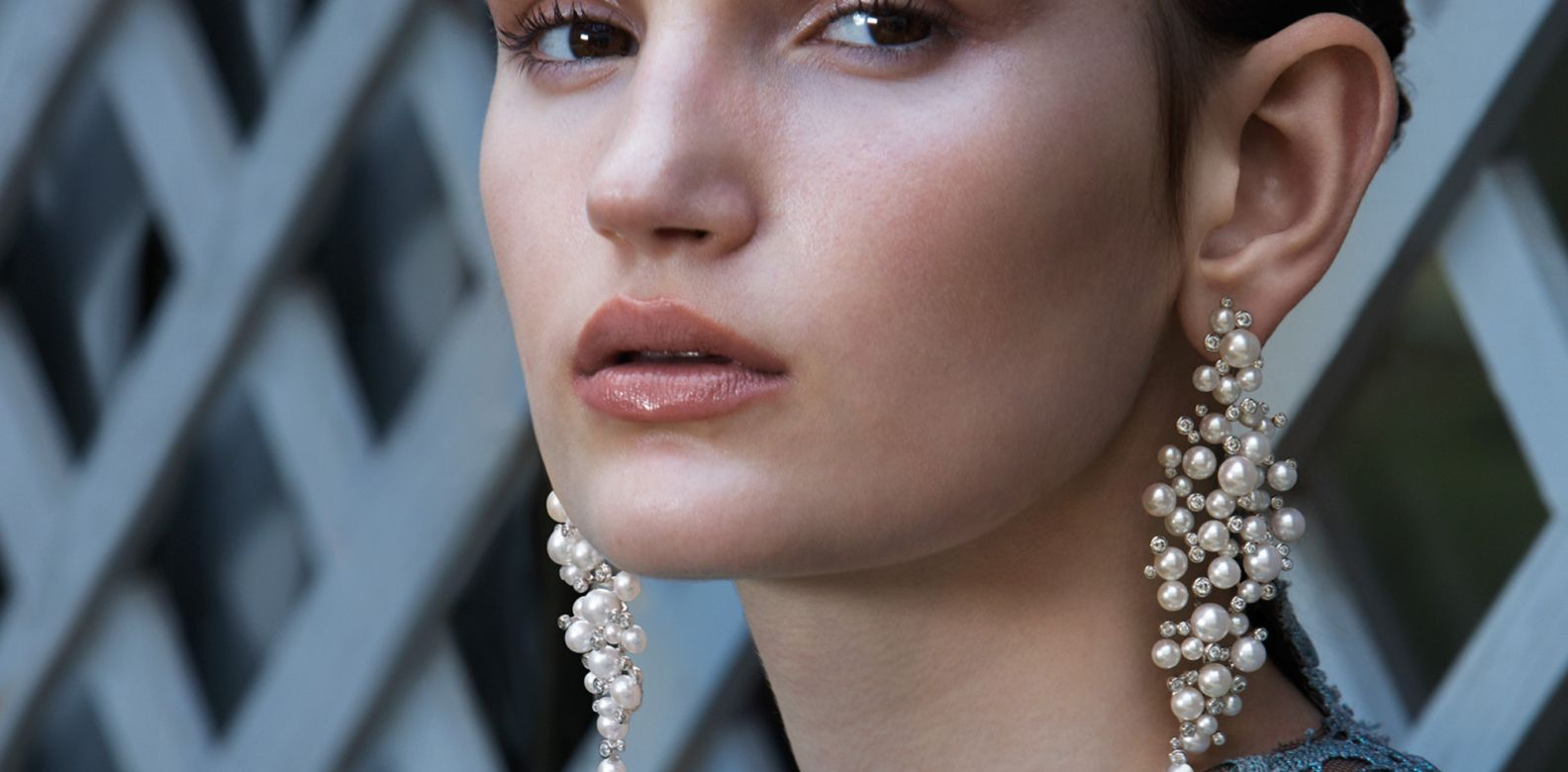 Perles Givrées earrings in white gold set with pearls and diamonds, by Boucheron; dress by Valentino