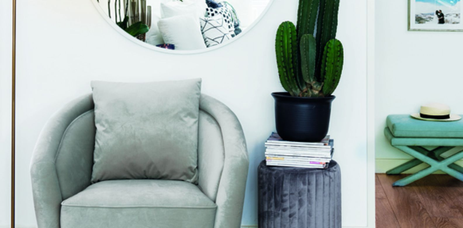 An inviting velvet armchair and ottoman invite you to take a moment's repose and appreciate your surroundings.