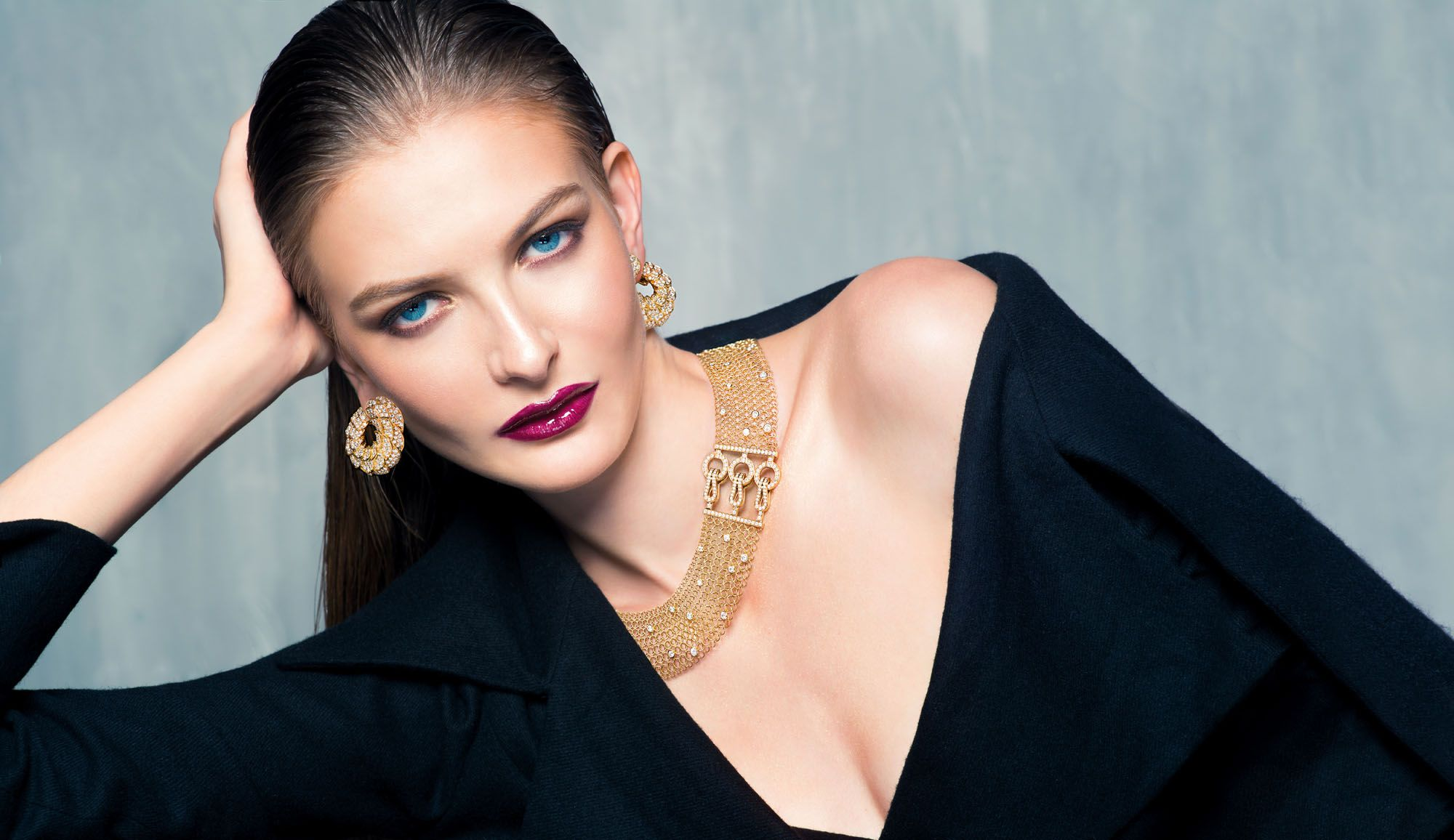 CLASS ACT: Earrings in yellow gold set with diamonds, and a necklace in pink gold set with diamonds, both by Cartier; coat by P'IA