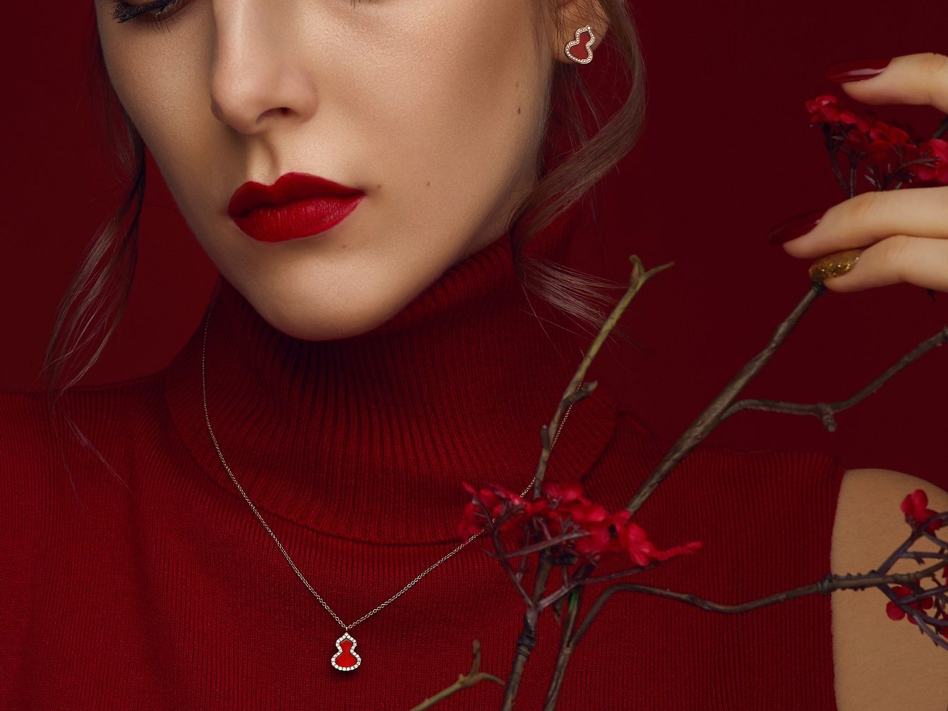Qeelin Wulu Red Agate pendant and earrings in rose gold set with diamonds and red agate (Photo: Courtesy of Qeelin)