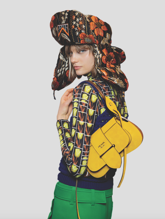 """Cloqué hat with ear flaps by Prada. Available at <a href="""" https://www.prada.com/hk/en/products.cloqu%C3%A9_hat_with_ear_flaps.1HC164_1S3R_F0049.html"""">Prada</a>"""