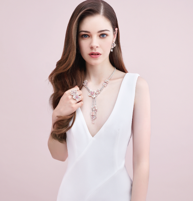 Necklace, earrings and ring with mother-of-pearl, pink sapphires and diamonds by Nuò by Cindy Yeung