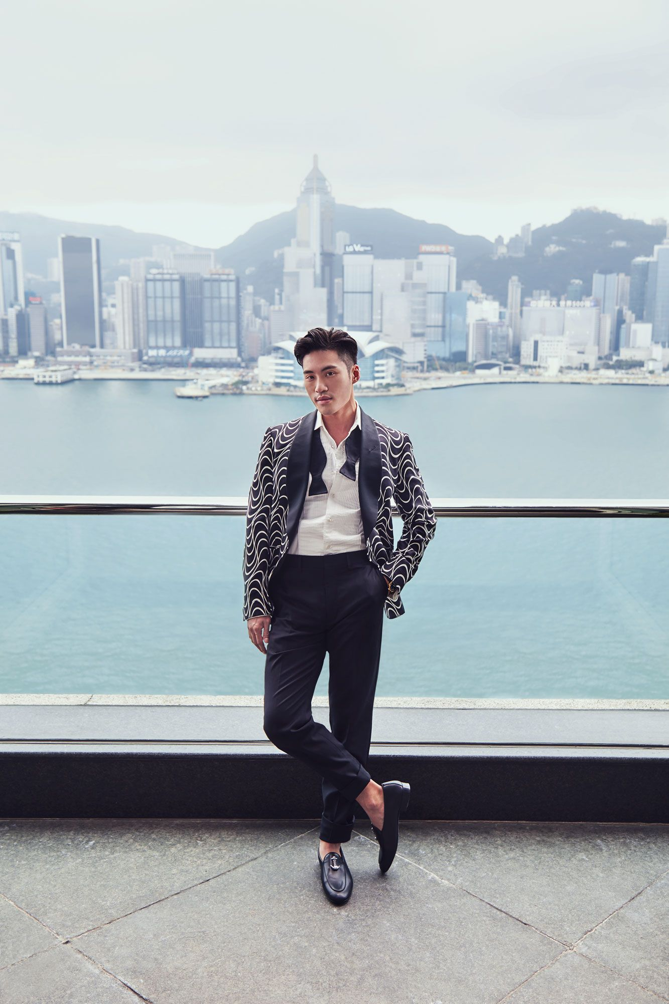 Loui wears a jacket, shirt, trousers, bow tie by Ralph Lauren Purple Label; shoes by Giuseppe Zanotti (Photography: Dino Busch/Hong Kong Tatler)