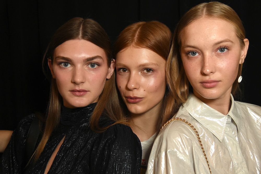 Models pose backstage for Staud during New York Fashion Week (Photo by Yuchen Liao/Getty Images for NYFW: The Shows)