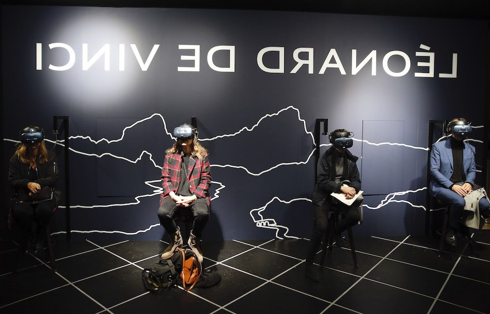 Visitors at the Leonardo da Vinci virtual reality exhibit at the Louvre in Paris. France (Photo by Chesnot/Getty Images)