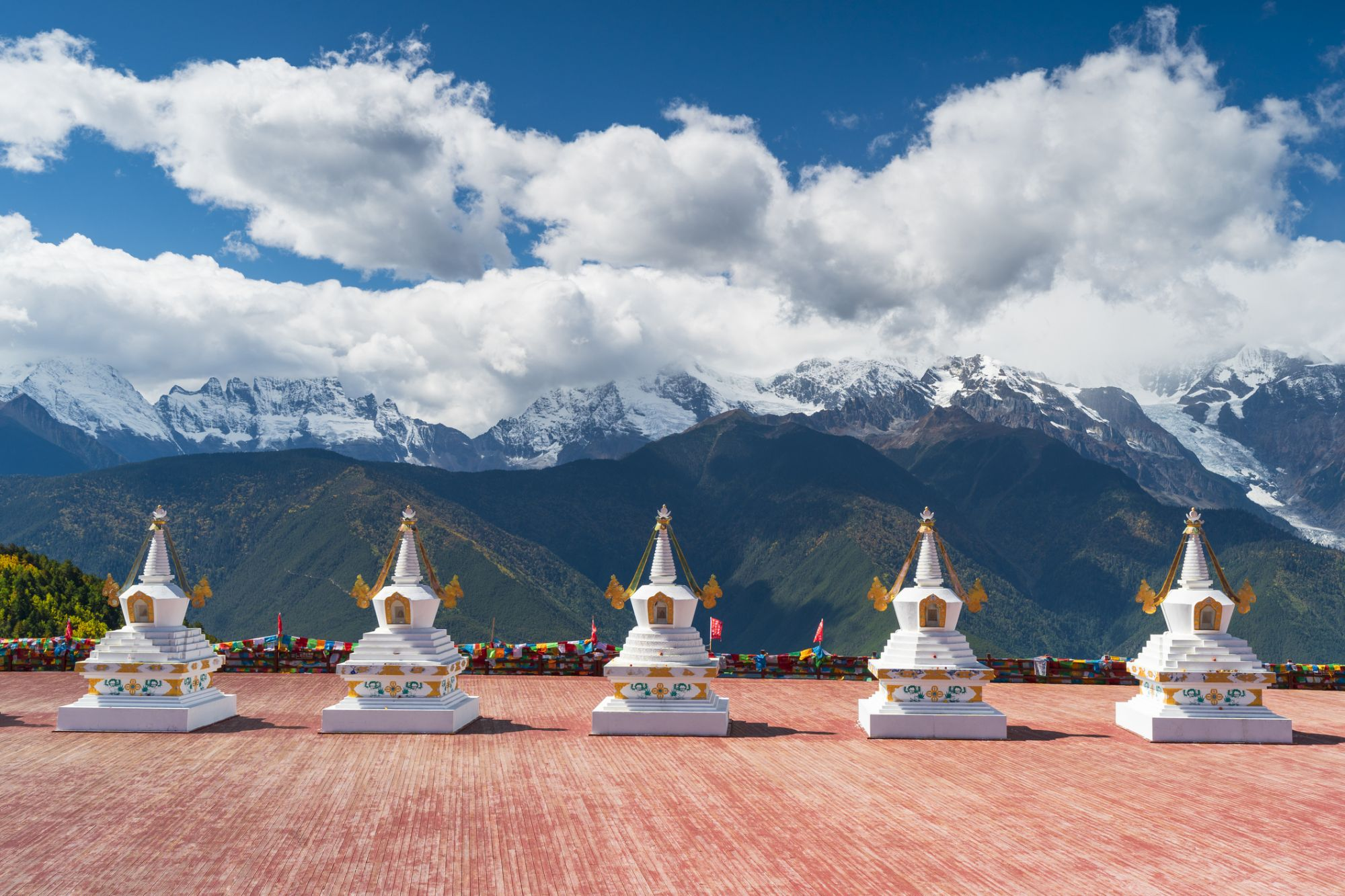 Stupa and the Meili snow mountain range in Deqen county, Diqing Tibetan Autonomous Prefecture of southwest China's Yunnan Province