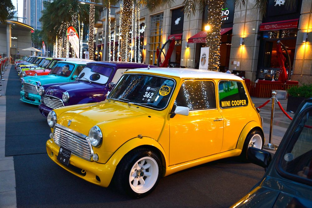 A row of pop coloured Mini Coopers at the 8th Emirates Classic Car Festival 2016 in Dubai  (Photo by Rubina A. Khan/Getty Images)