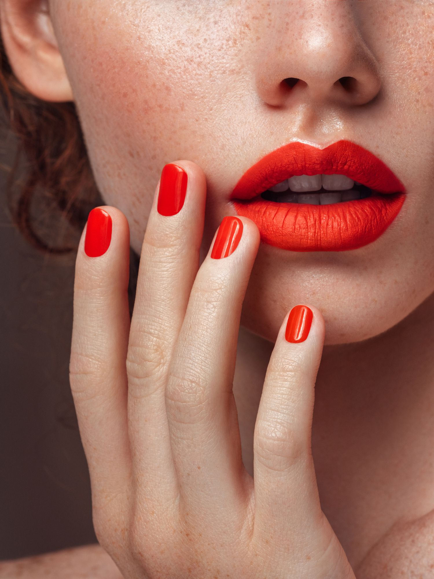 Woman's red lips and manicure close-up