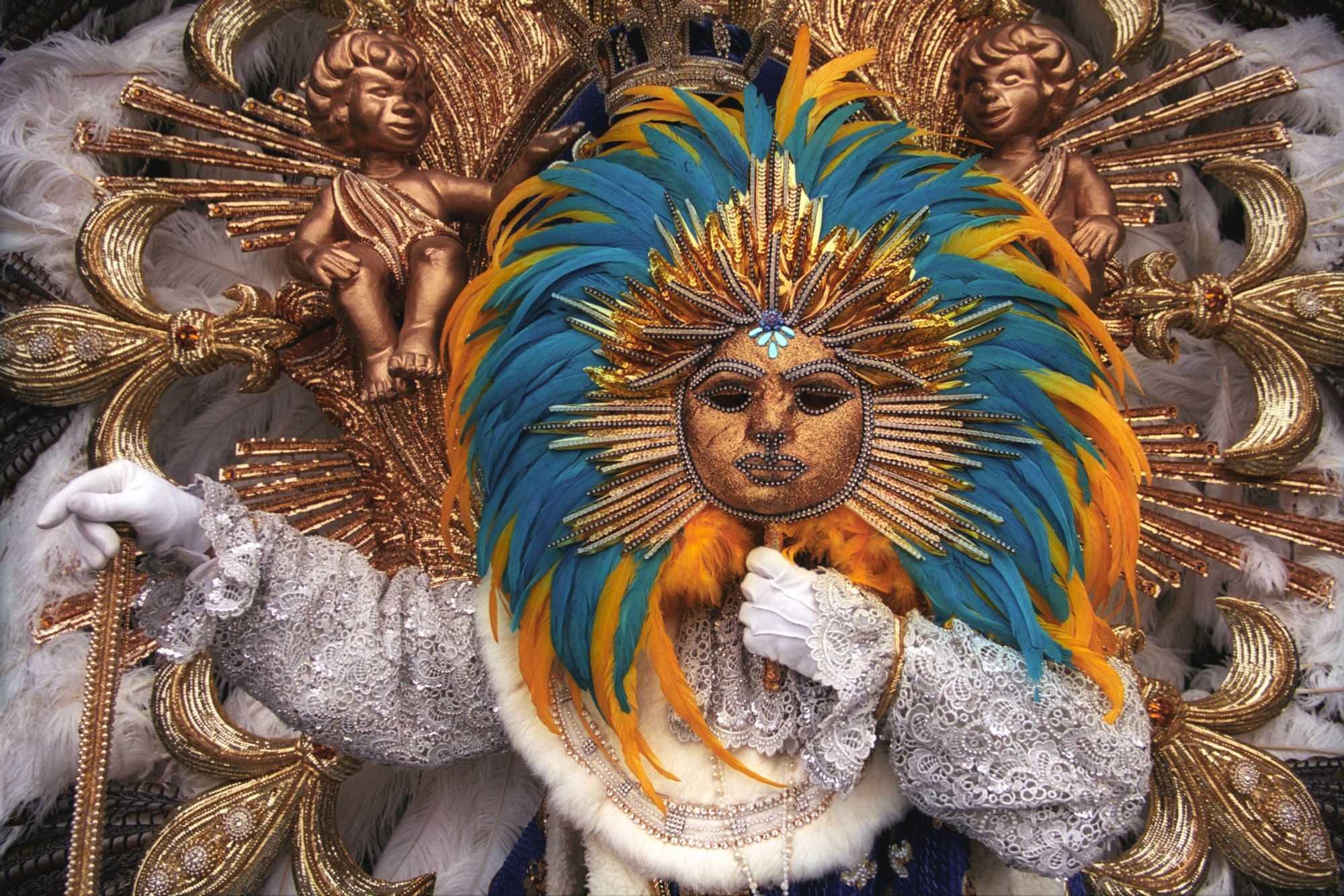 "A beautiful mask of ""Le Roi Soleil"", the french king Louis XIV represented in the brazilian carnival of Rio de Janeiro."