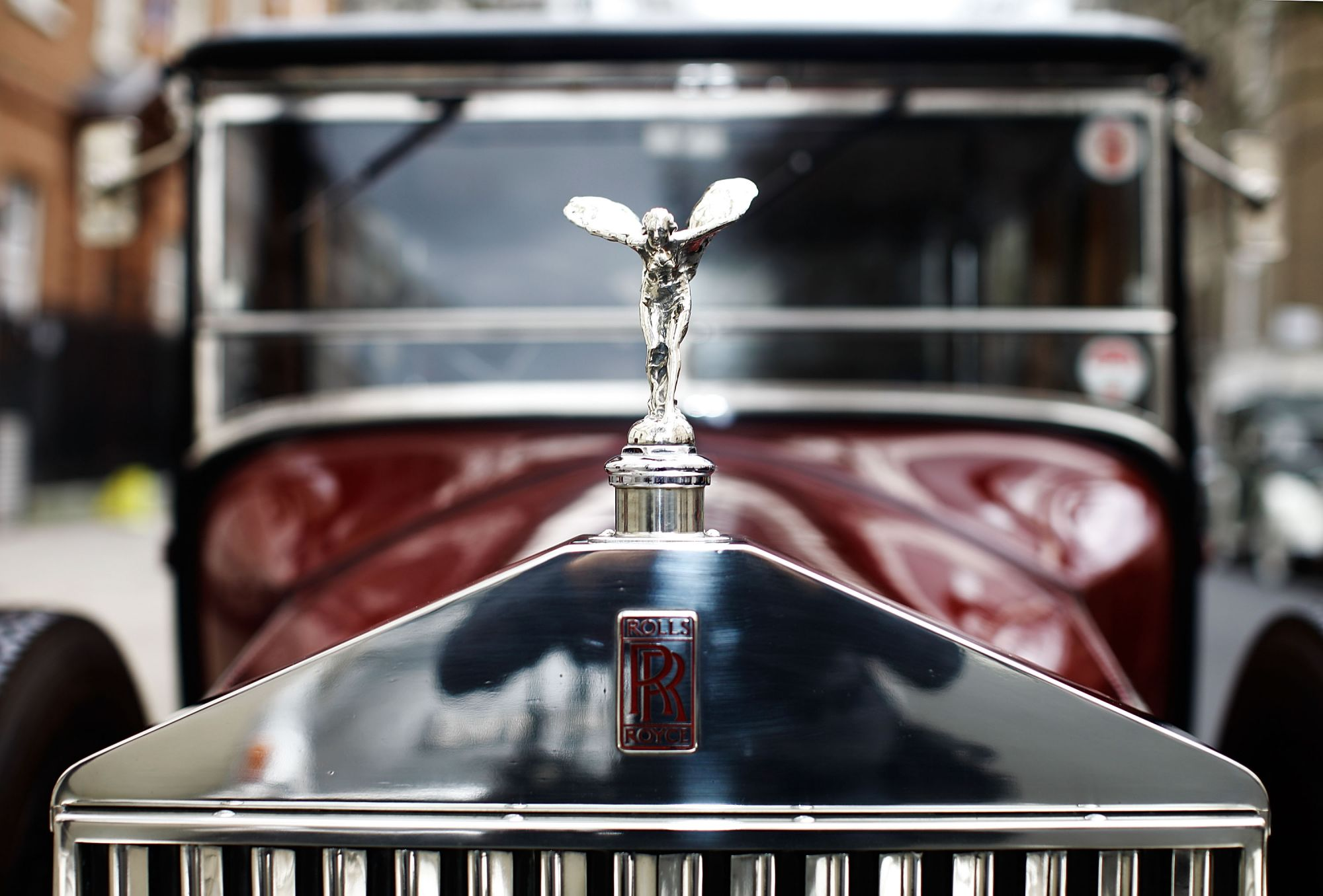 LONDON, ENGLAND - FEBRUARY 06:  Vintage Rolls Royce cars line up before a centenary parade on February 6, 2011 in London, England. Rolls Royce is celebrating the 100th anniversary of the introduction of the ÔSpirit of EcstasyÕ or ÔFlying LadyÕ icon that is found on the front of their cars.  (Photo by Matthew Lloyd/Getty Images)