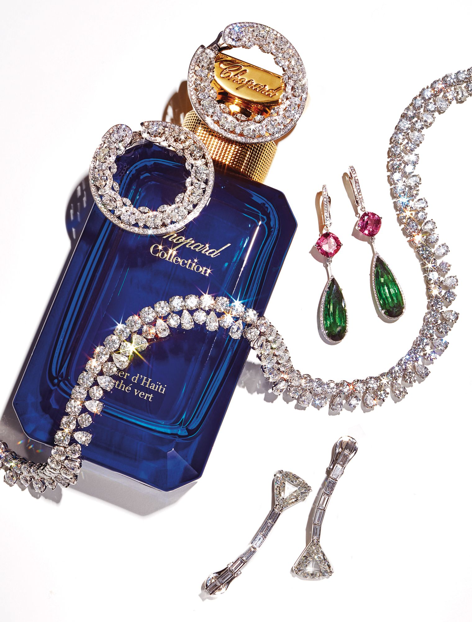 Precious Lace earrings in white gold and titanium set with diamonds; Temptations earrings in white gold set with green and pink tourmalines and diamonds; necklace in white gold set with diamonds; Solitaire earrings in white gold set with diamonds. Vétiver d'Haïti au Thé Vert perfume, all by Chopard