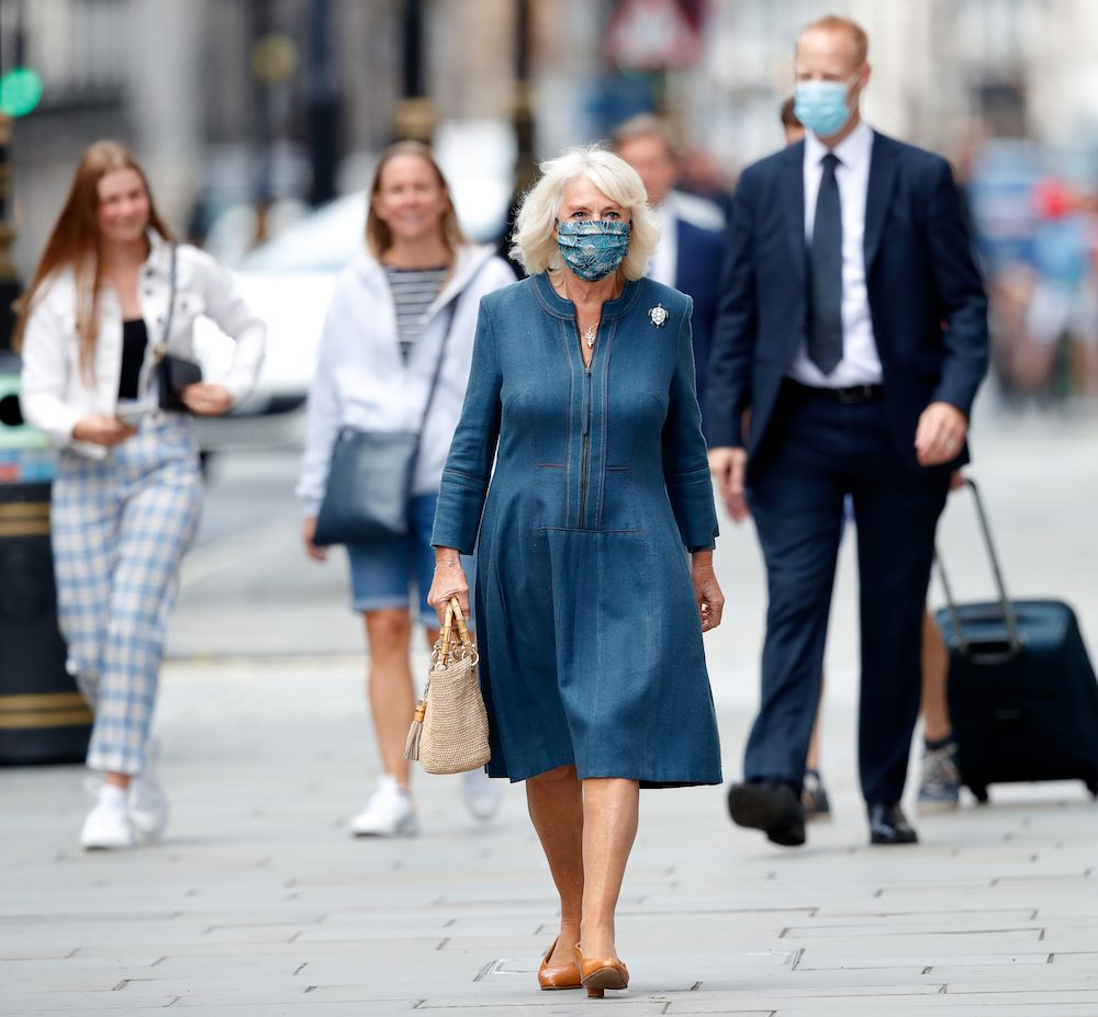 Camilla, Duchess of Cornwall seen wearing a peacock feather patterned face mask visits the recently reopened National Gallery to meet with staff involved in the organisation's Covid-19 response and reopening process (Photo: Getty Images)