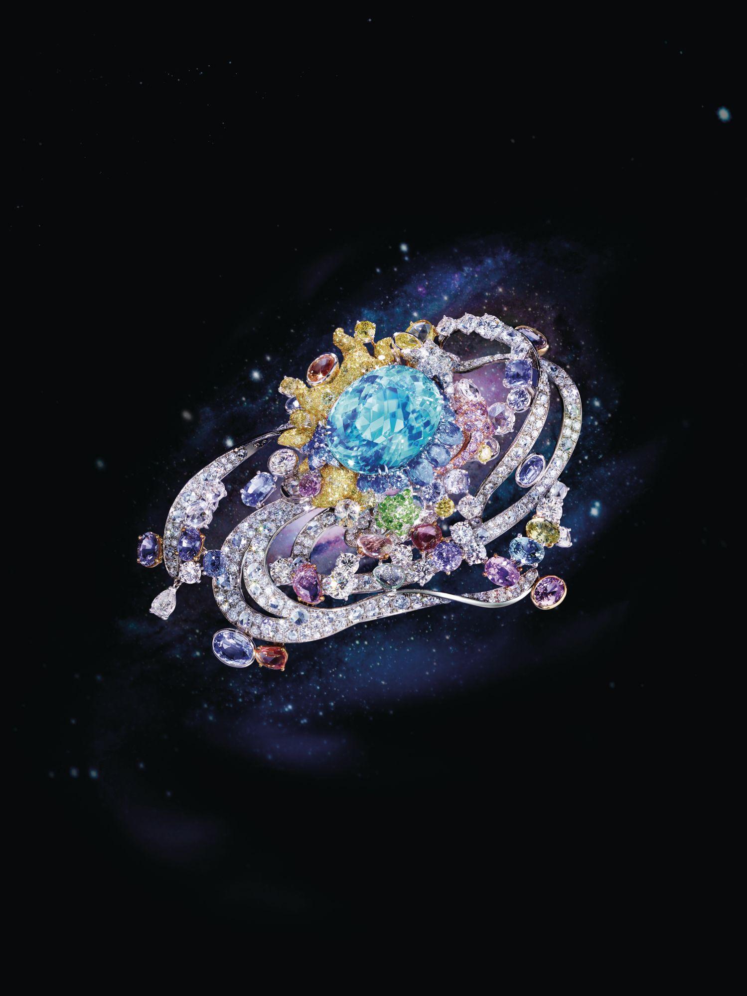 Côté d'Célesté brooch in titanium set with a Paraiba tourmaline, coloured sapphires and diamonds by Anna Hu