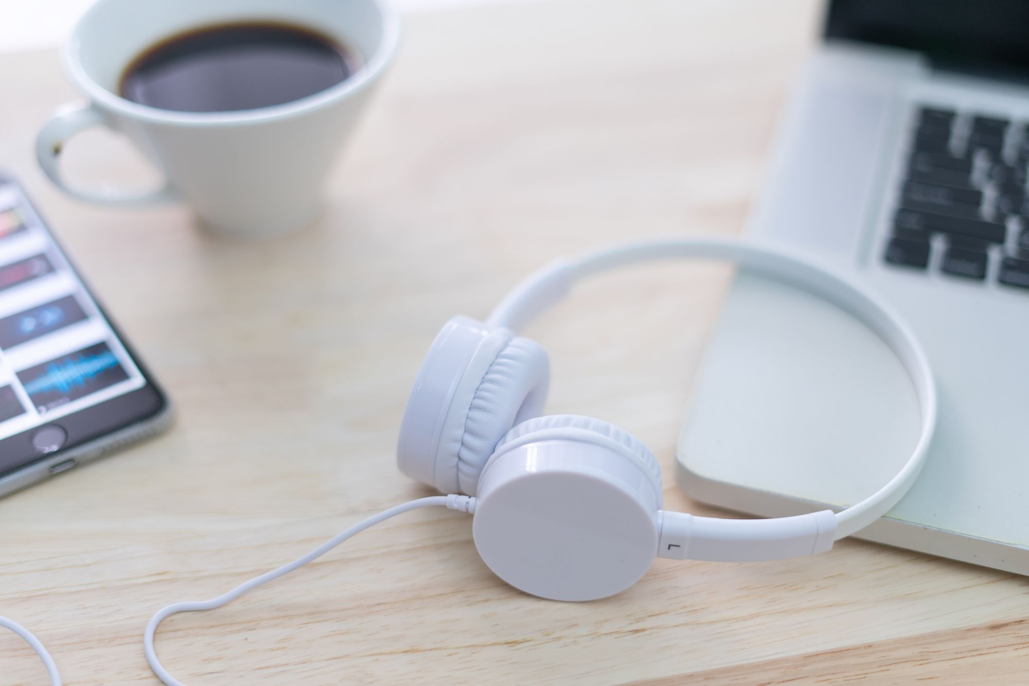 Headphone with Laptop on the table.