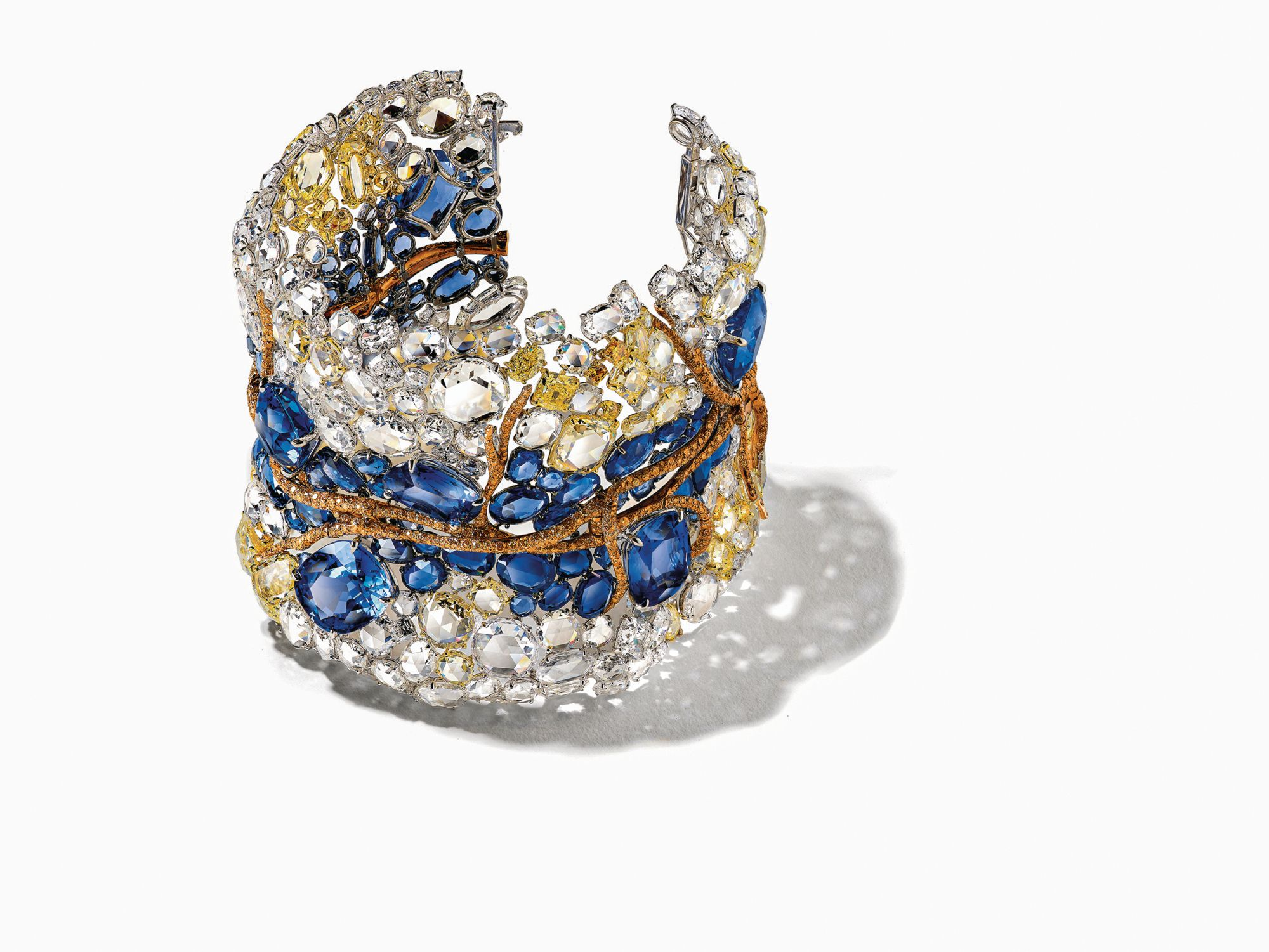 "2020 Black Label Masterpiece VI ""Reflection Bangle"" in white and yellow gold set with sapphires and diamonds by Cindy Chao (Photo: Courtesy of Cindy Chao)"