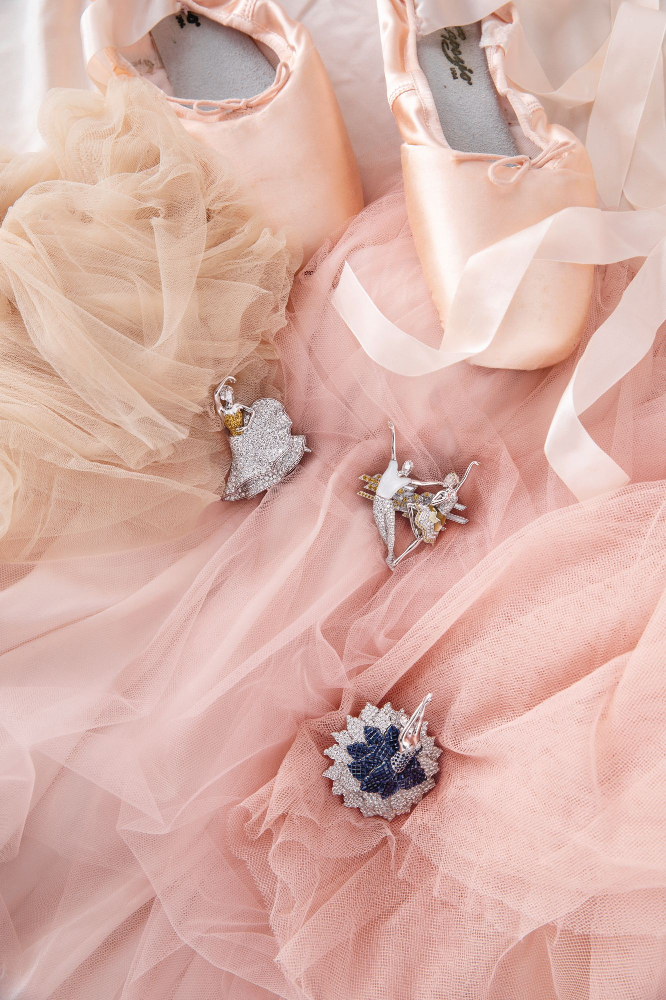 From top: Sylphide ballerina clip in white and yellow gold set with pink and yellow sapphires and diamonds; Pas de Deux transformable clip in white gold set with yellow sapphires, white and golden mother-of-pearl and diamonds; Sacre du Printemps ballerina clip in white and rose gold set with sapphires and diamonds, all by Van Cleef & Arpels (Image: Affa Chan/Tatler Hong Kong)
