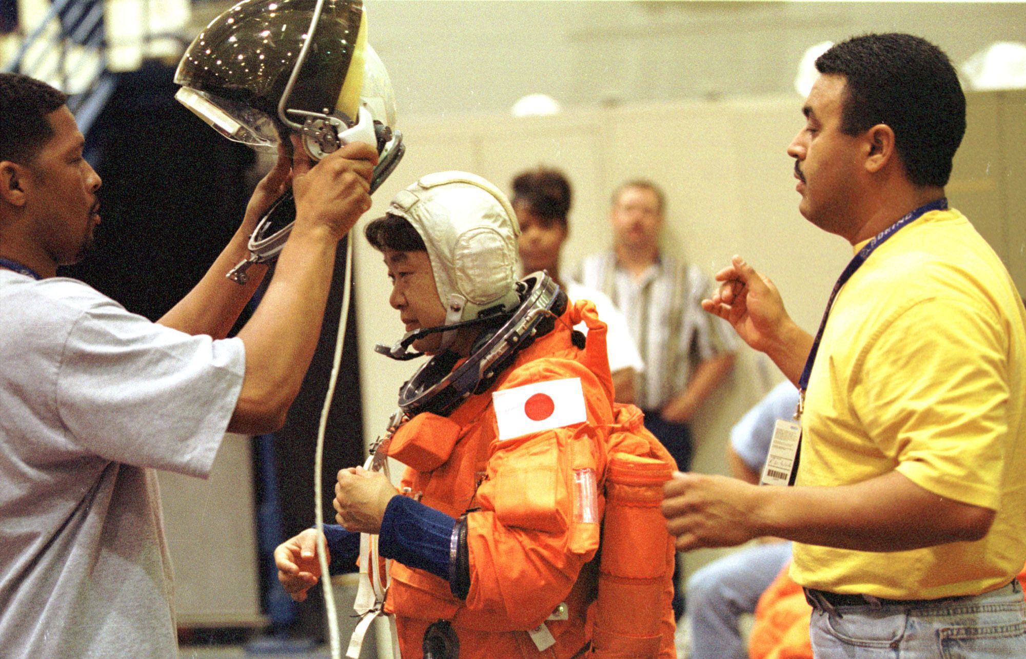 Japanese Astronaut Chiaki Mukai, Center, Is Helped Into Her Space Helmet By Nasa Technicians During Crew Escape Training Monday, June 1, 1998, At Nasa's Johnson Space Center In Houston. (Gamma Liaison  (Photo By Paul S. Howell/Getty Images)