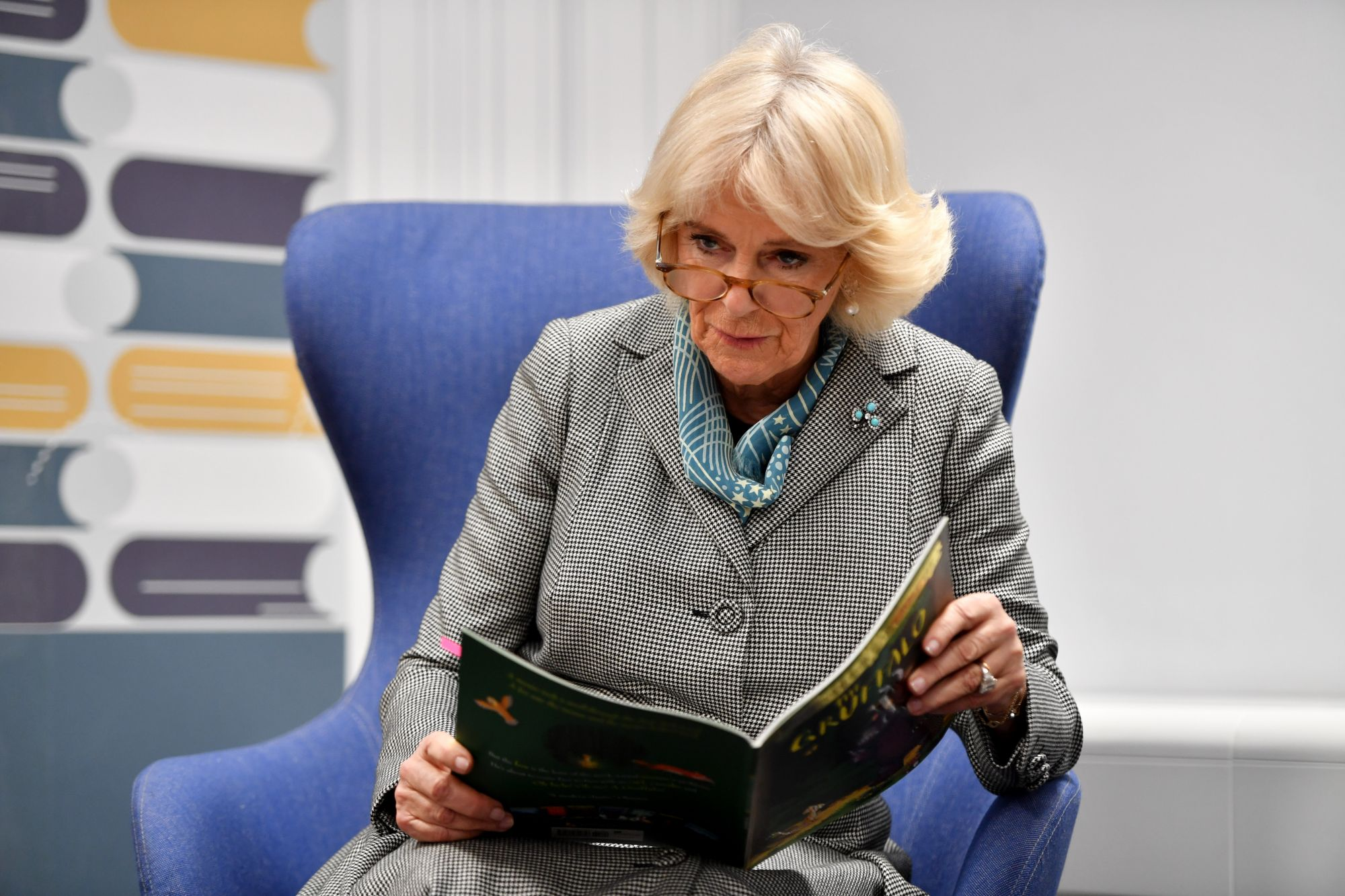 """WALSALL, ENGLAND - JANUARY 22: Camilla, Duchess of Cornwall reads """"The Gruffalo"""" by Julia Donaldson to a Tiny Tots group during the official opening of Lichfield Street Hub on January 22, 2020 in Walsall, England. (Photo by Anthony Devlin -WPA Pool/Getty Images)"""
