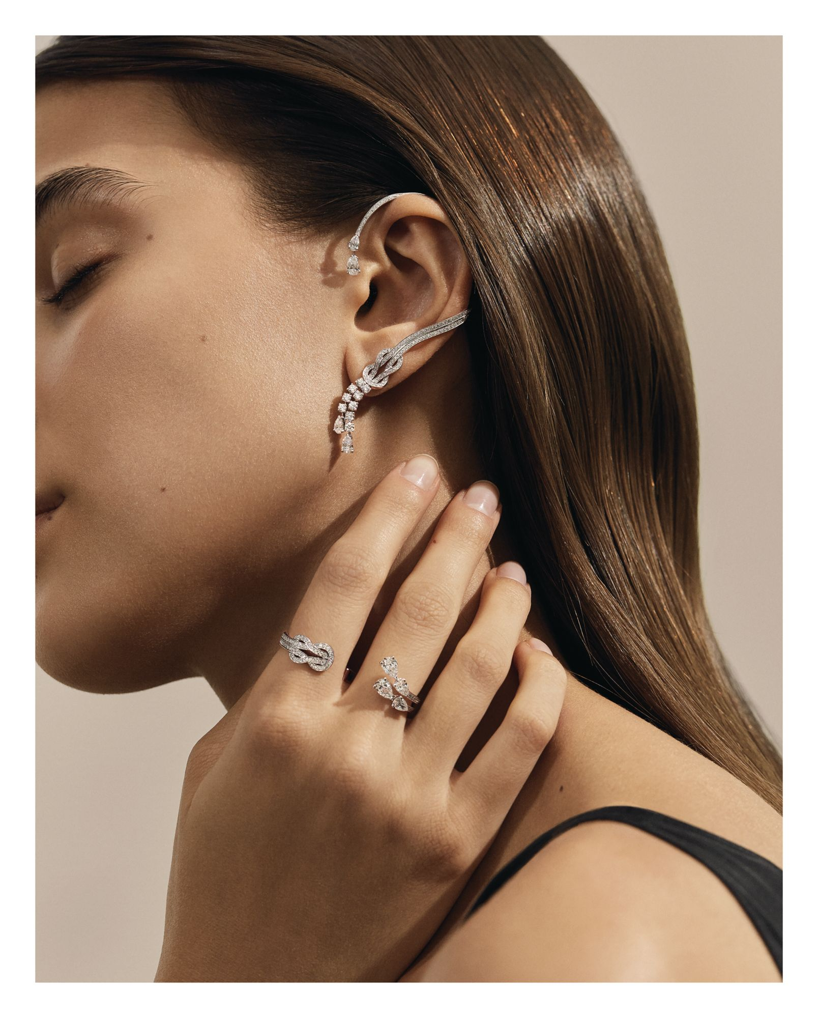 Chance Infinie ear cuff and double ring in white gold set with diamonds, both by Fred