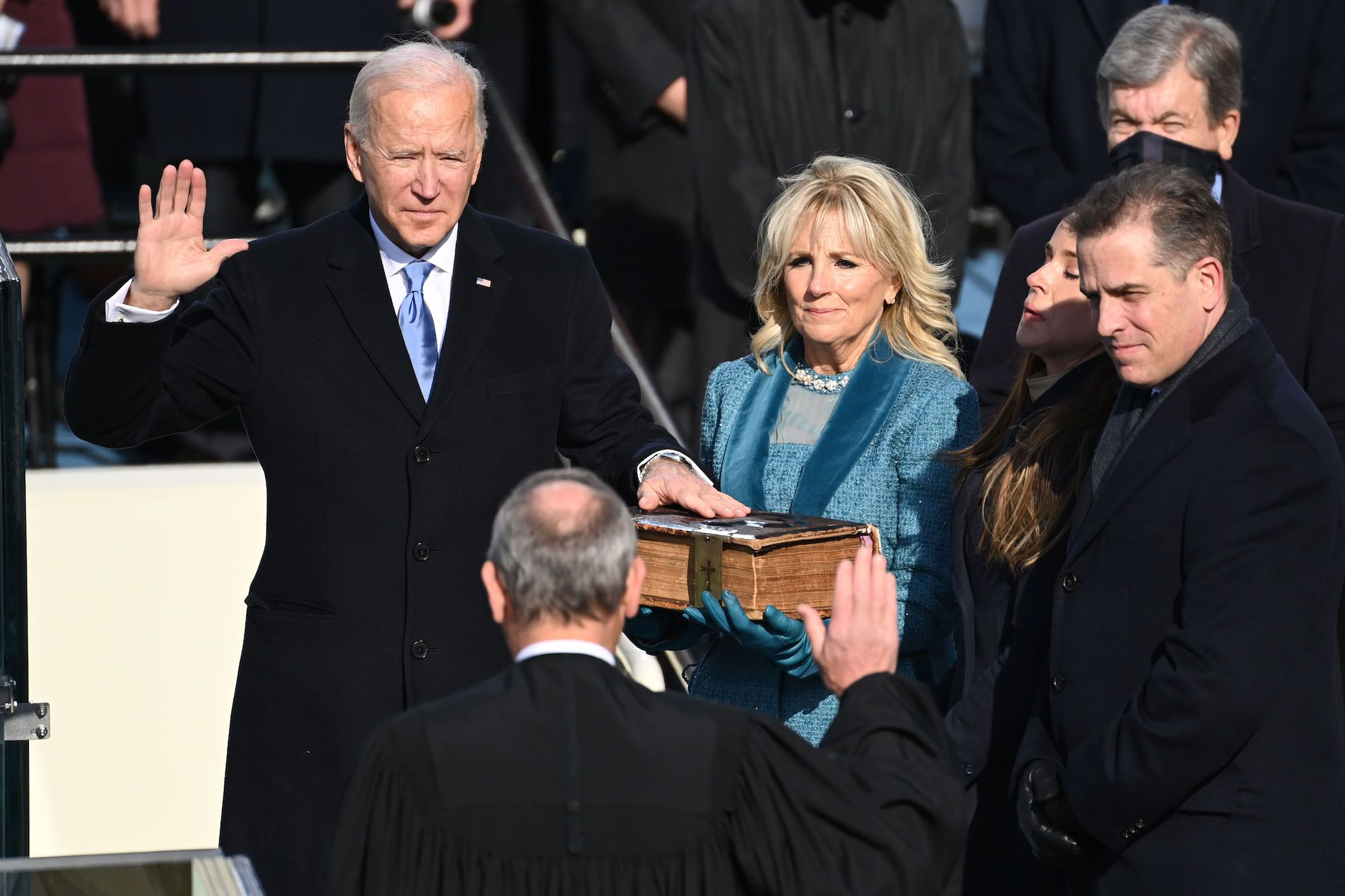 WASHINGTON, DC - JANUARY 20: US President-elect Joe Biden is sworn in as his wife Jill Biden holds the Bible during the 59th Presidential Inauguration at the U.S. Capitol on January 20, 2021 in Washington, DC. During today's inauguration ceremony Joe Biden becomes the 46th president of the United States. (Photo by Saul Loeb - Pool/Getty Images)