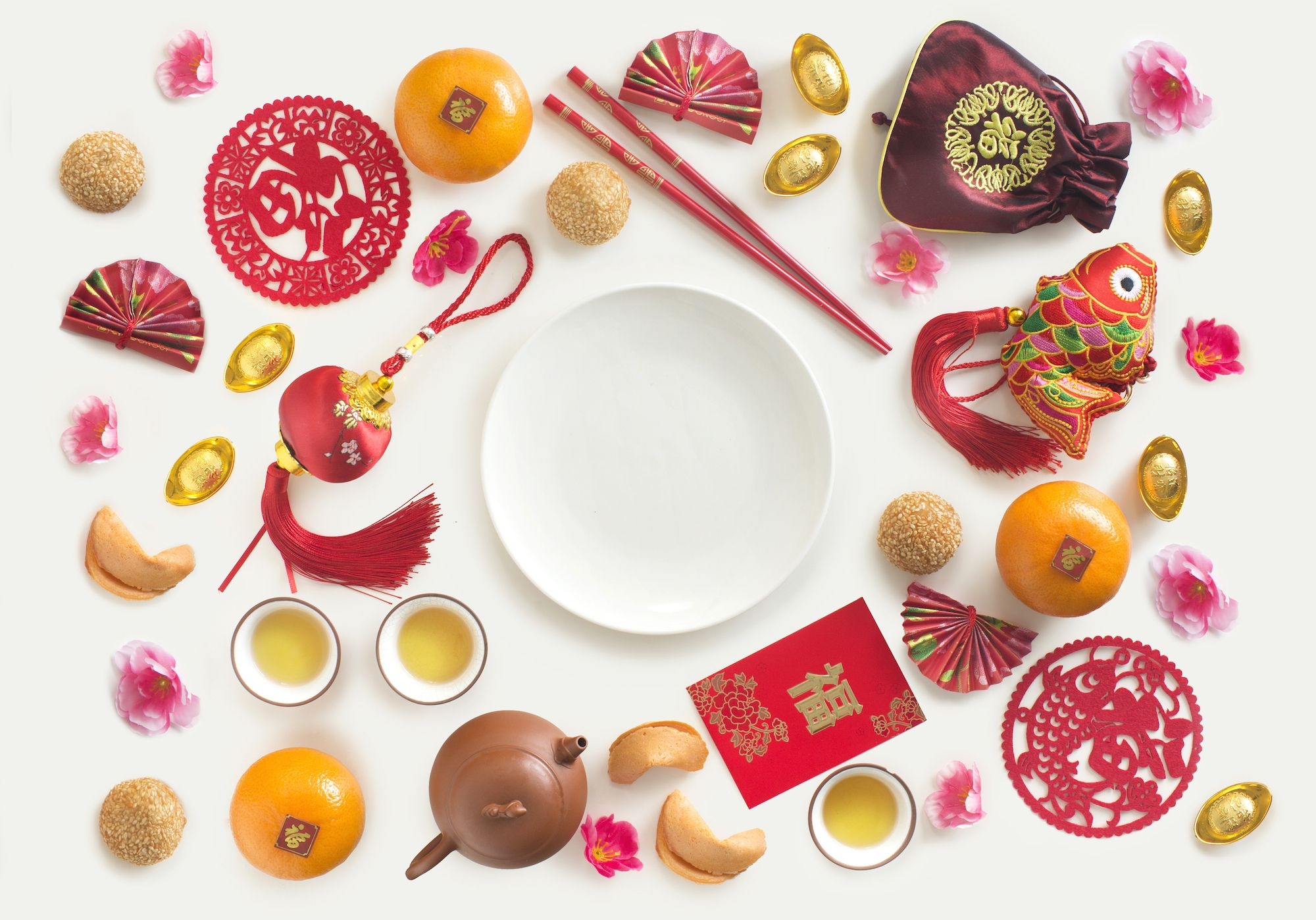 "A group of different oriental style decorative items with text ""Prosperity"" and Chinese food and drinks on white background. Flat lay text space image."