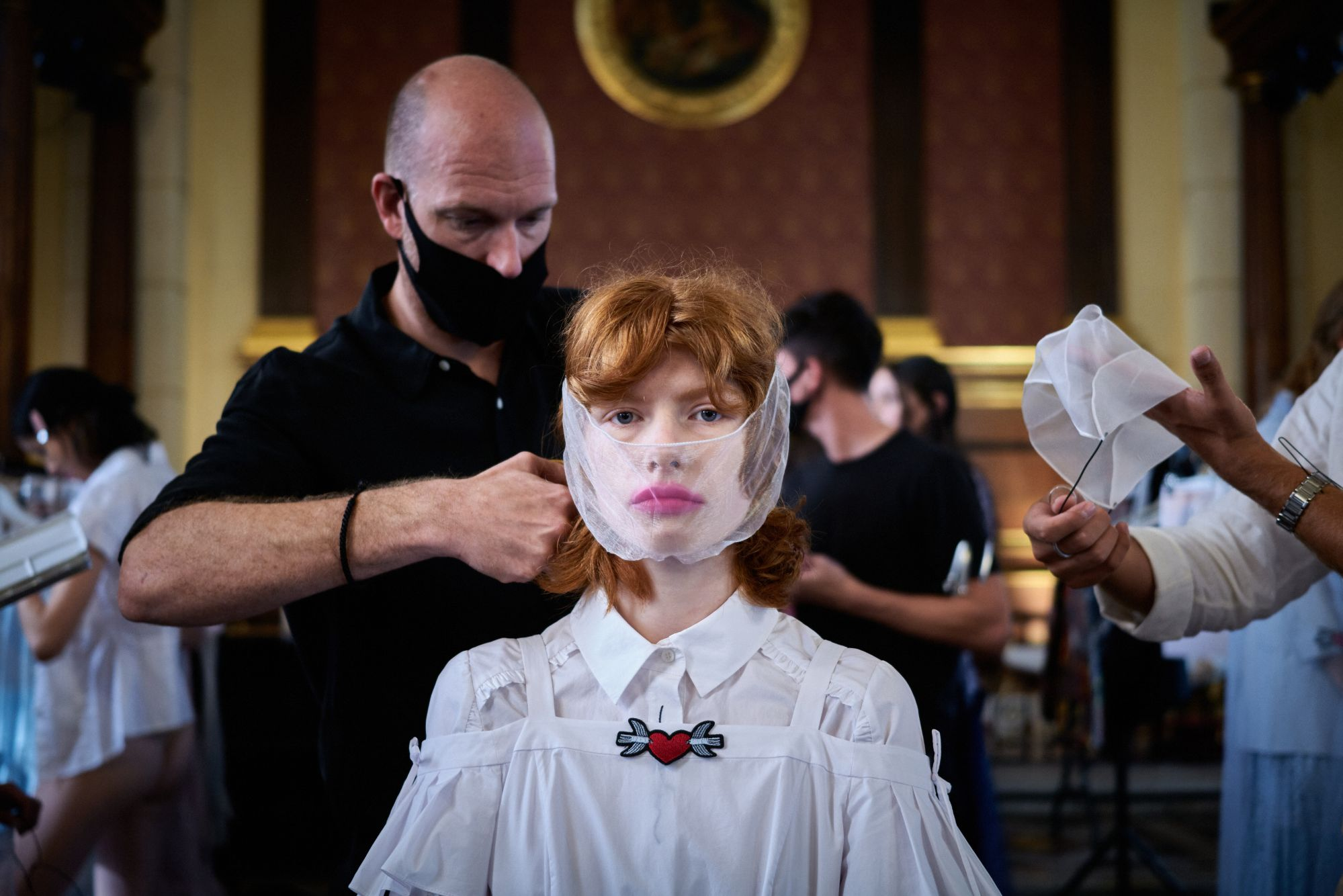 A model backstage ahead of the Bora Aksu show during LFW September 2020 at The Waldorf London (photo: Gareth Cattermole/BFC/Getty Images)