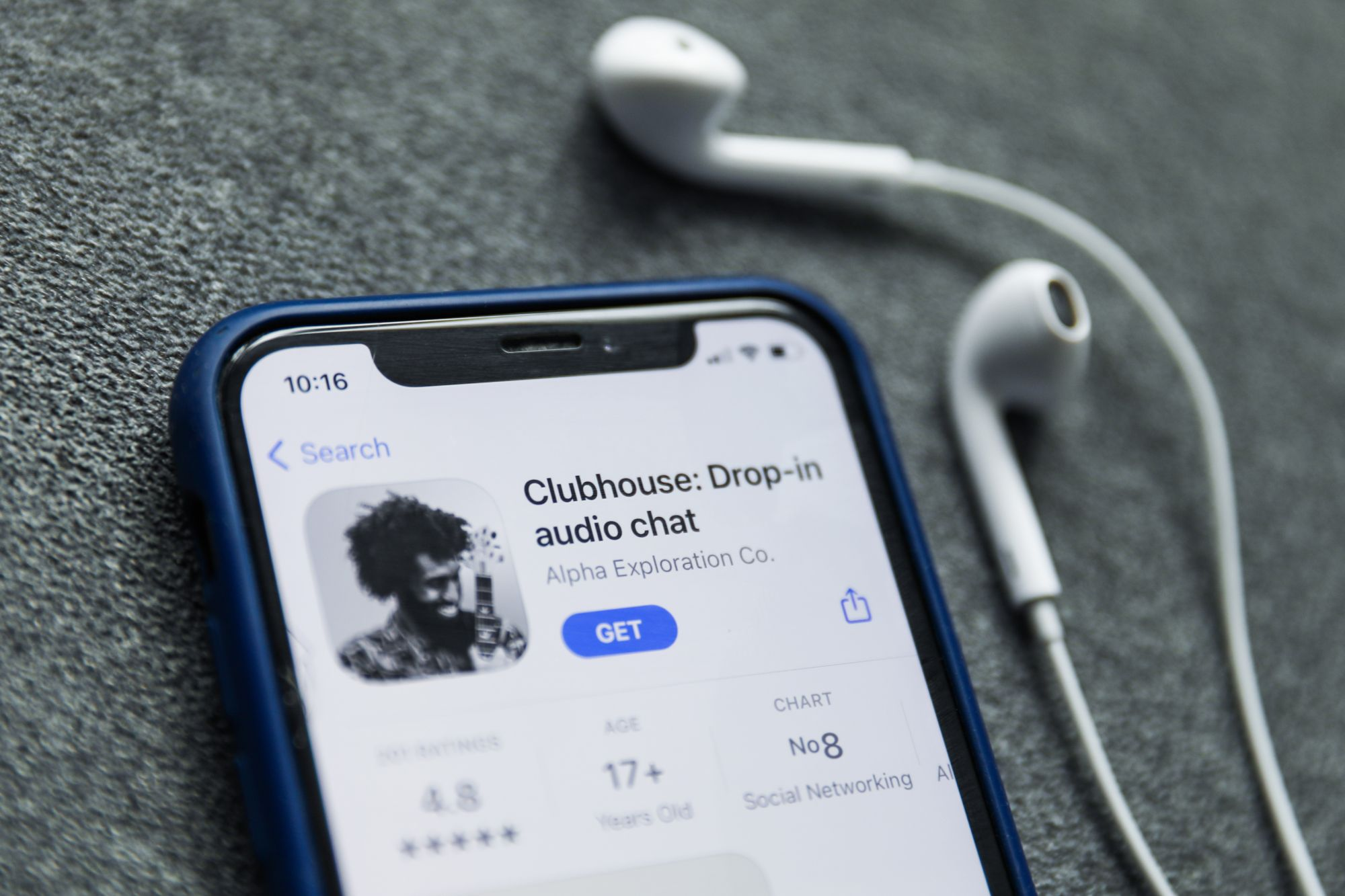 Clubhouse Drop-in audio chat app logo on the App Store is seen displayed on a phone screen in this illustration photo taken in Poland on February 3, 2021.  (Photo illustration by Jakub Porzycki/NurPhoto via Getty Images)