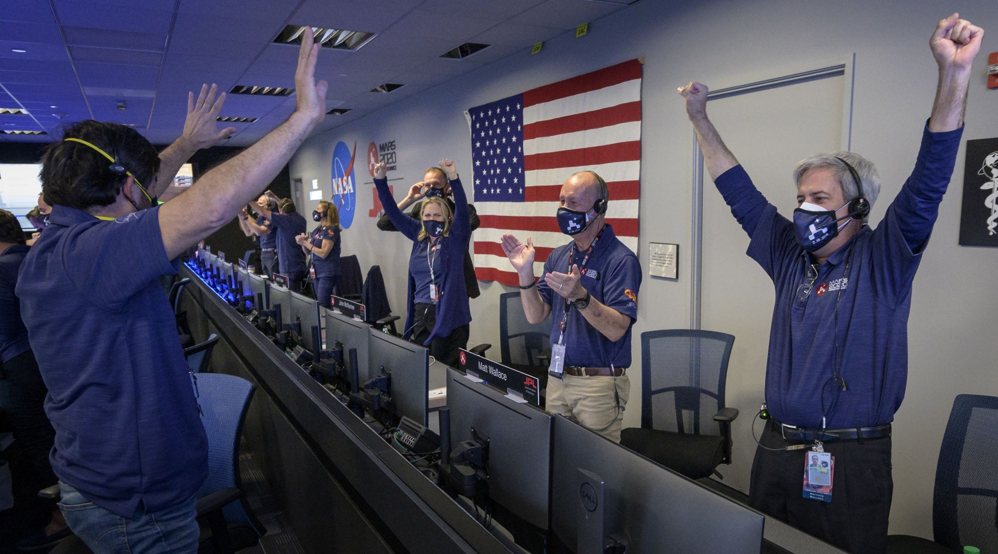 PASADENA, CA - FEBRUARY 18:  In this handout image provided by NASA, members of NASA's Perseverance rover team react in mission control after receiving confirmation the spacecraft successfully touched down on Mars, , February 18, 2021 at NASA's Jet Propulsion Laboratory in Pasadena, California.  A key objective for Perseverance's mission on Mars is astrobiology, including the search for signs of ancient microbial life. The rover will characterize the planet's geology and past climate, paving the way for hum