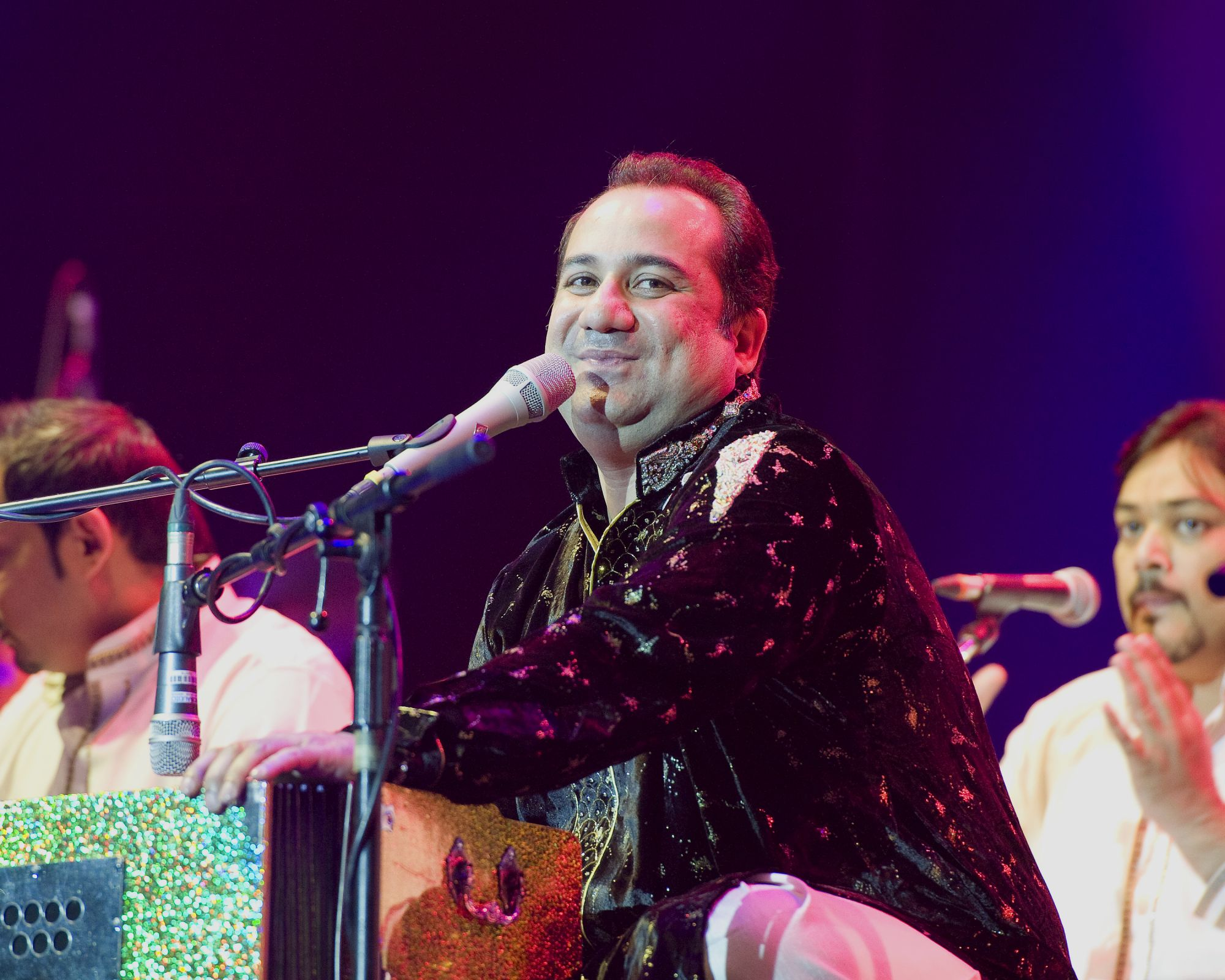 LONDON, UNITED KINGDOM - AUGUST 25: Rahat Fateh Ali Khan performs on stage at O2 Arena on August 25, 2013 in London, England. (Photo by Robin Little/Redferns via Getty Images)