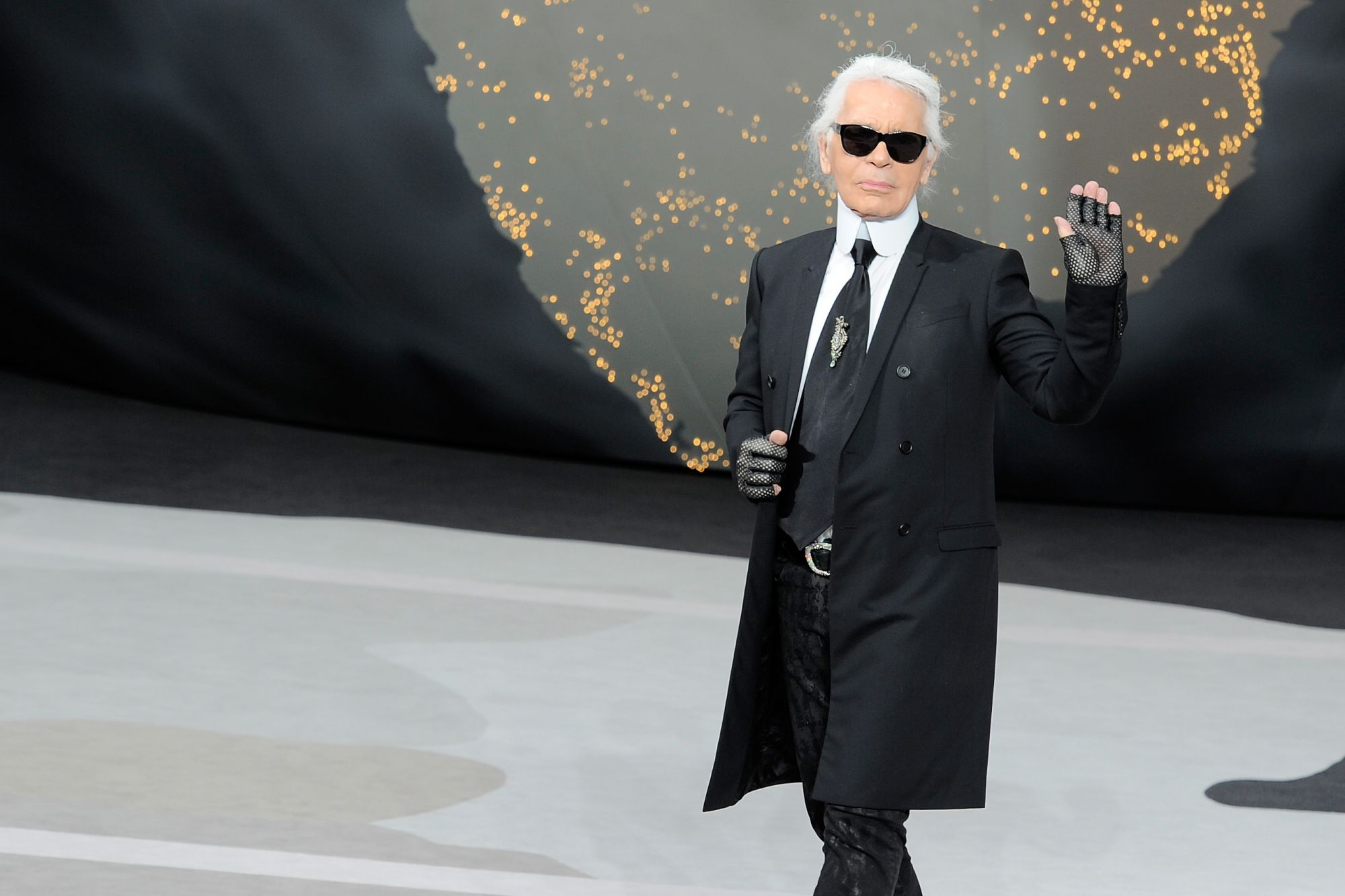 PARIS, FRANCE - MARCH 05:   Karl Lagerfeld walks the runway during the Chanel Fall/Winter 2013/14 Ready-to-Wear show as part of Paris Fashion Week at Grand Palais on March 5, 2013 in Paris, France.  (Photo by Kristy Sparow/FilmMagic)