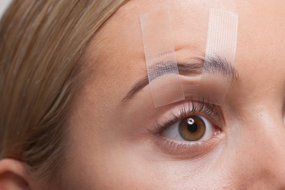 Why is everyone taping their face on social media? (photo: Getty Images)