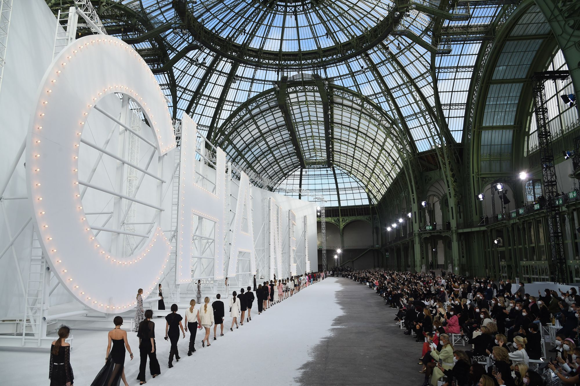PARIS, FRANCE - OCTOBER 06: Models  walk the runway during the Chanel Womenswear Spring/Summer 2021 show as part of Paris Fashion Week on October 06, 2020 in Paris, France. (Photo by Stephane Cardinale - Corbis/Corbis via Getty Images)