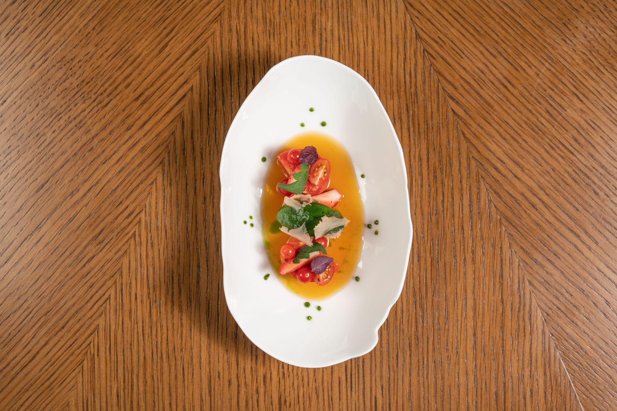 Fruit tomato, strawberry, shiso, tosazu vinegar, camelina oil and myoga at Amber