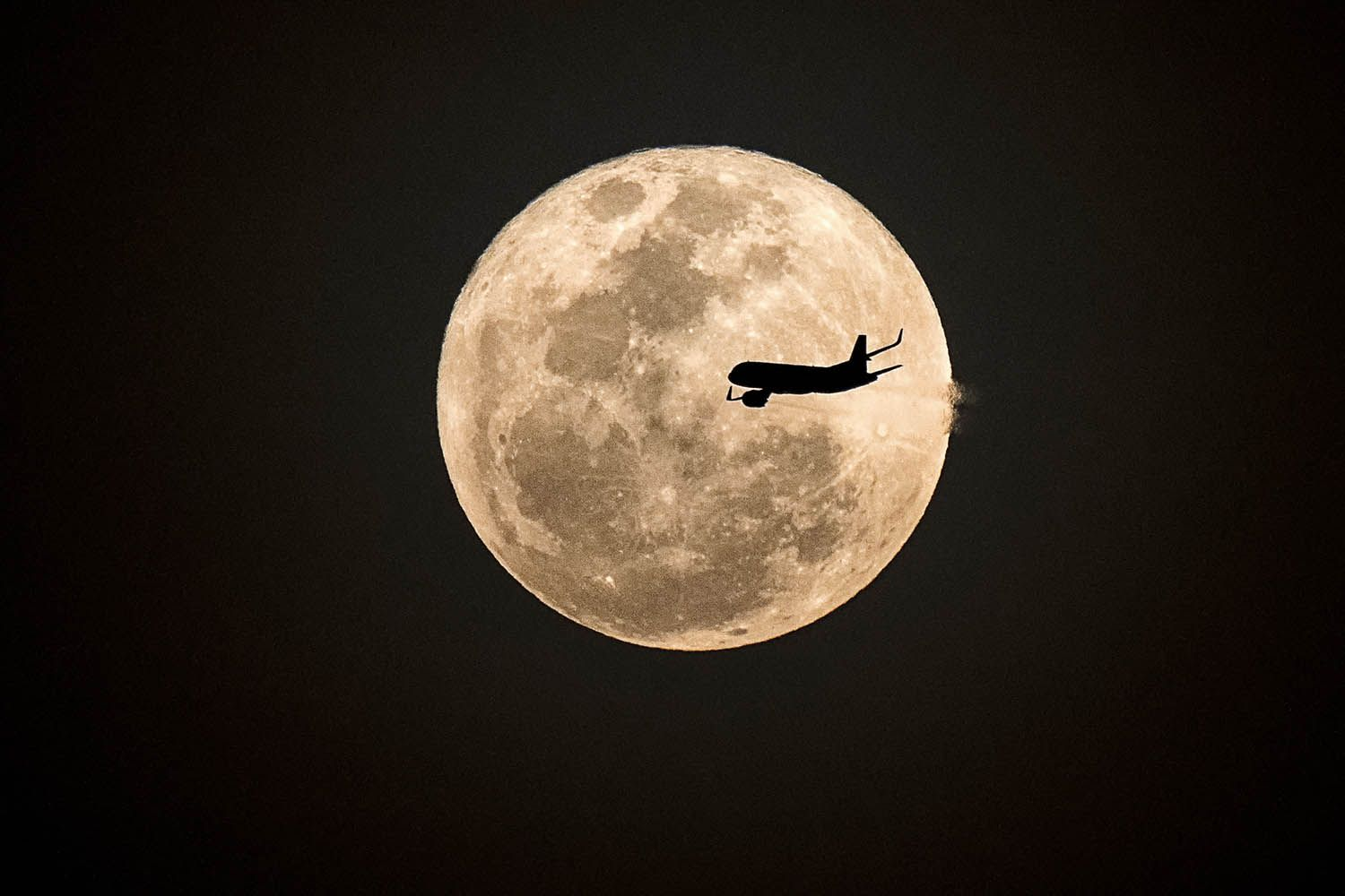 supermoon with plane in front of it